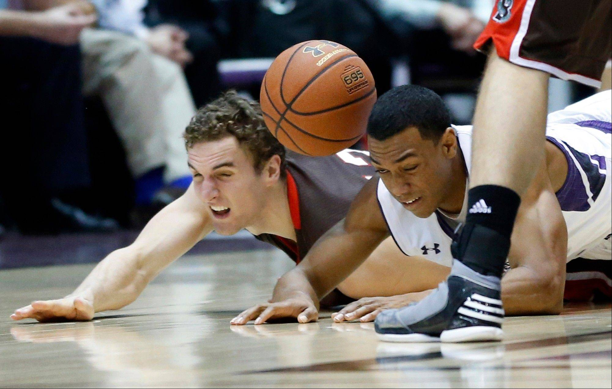 Northwestern guard James Montgomery III, right, and Brown forward Tyler Ponticelli battle for a loose ball during the second half of an NCAA college basketball game in Evanston, Ill., Sunday, Dec. 23, 2012. Northwestern won 63-42.