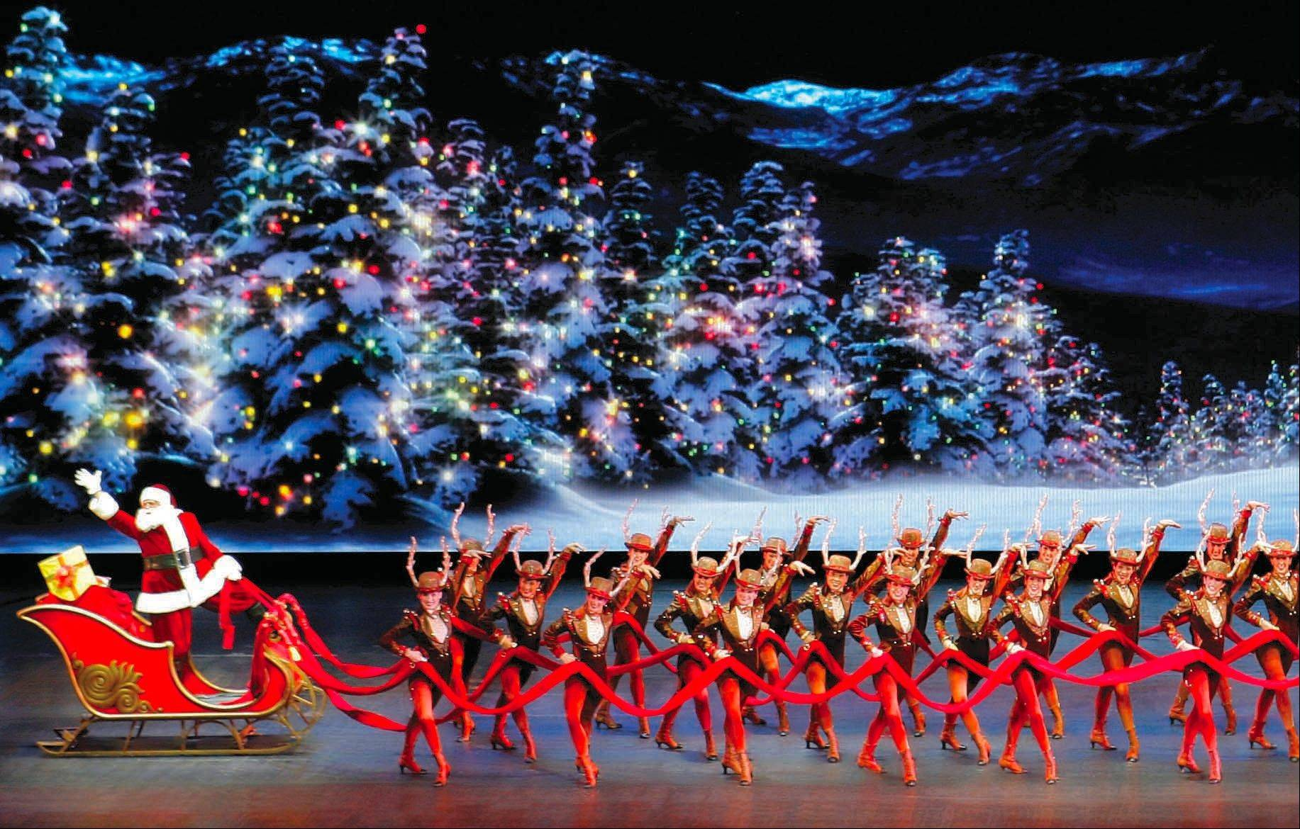 "Rockette reindeer lead Santa's sleigh in ""The Radio City Christmas Spectacular."""
