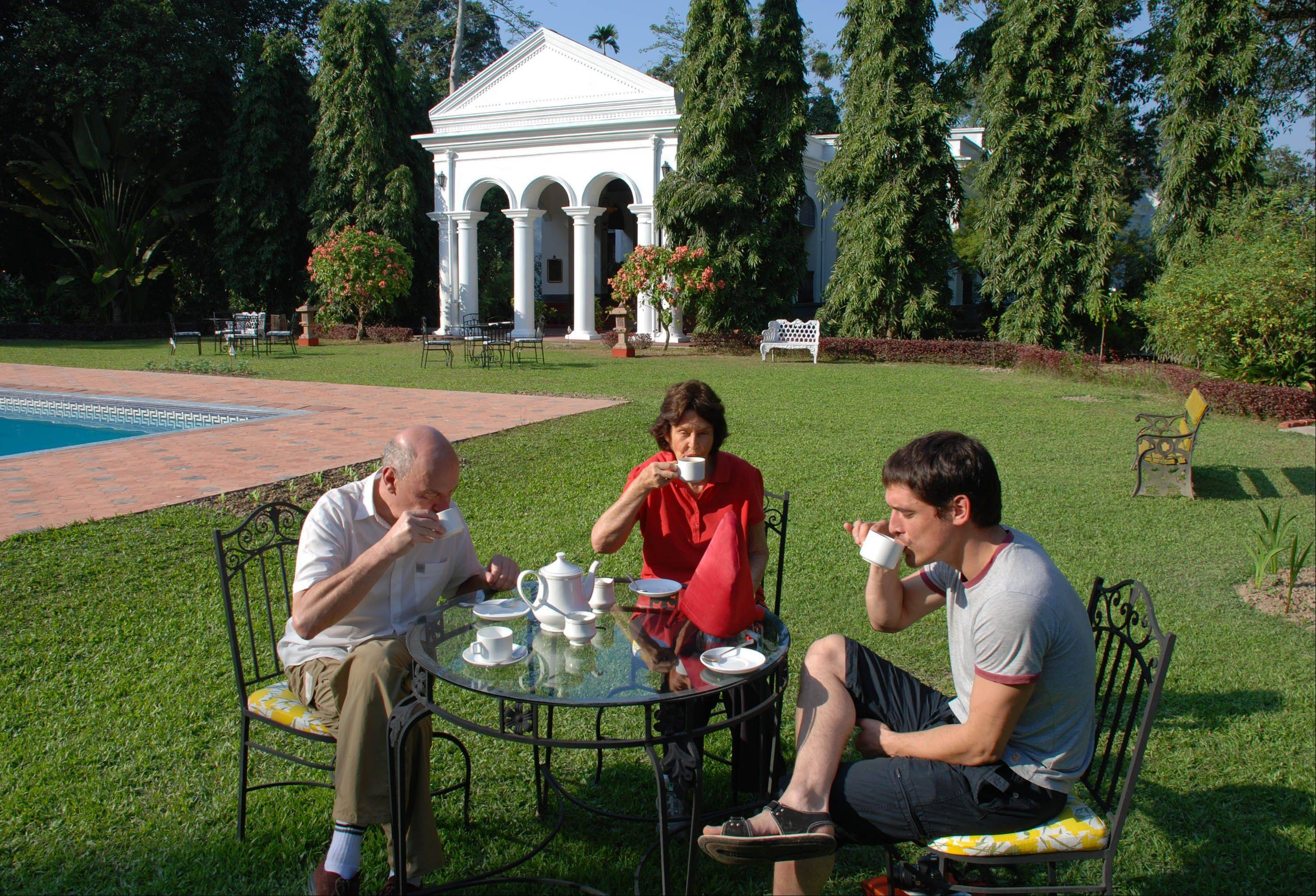 People enjoy afternoon tea, a heritage from British colonial days, on the lawn of Thengal Manor in Jorhat, India.
