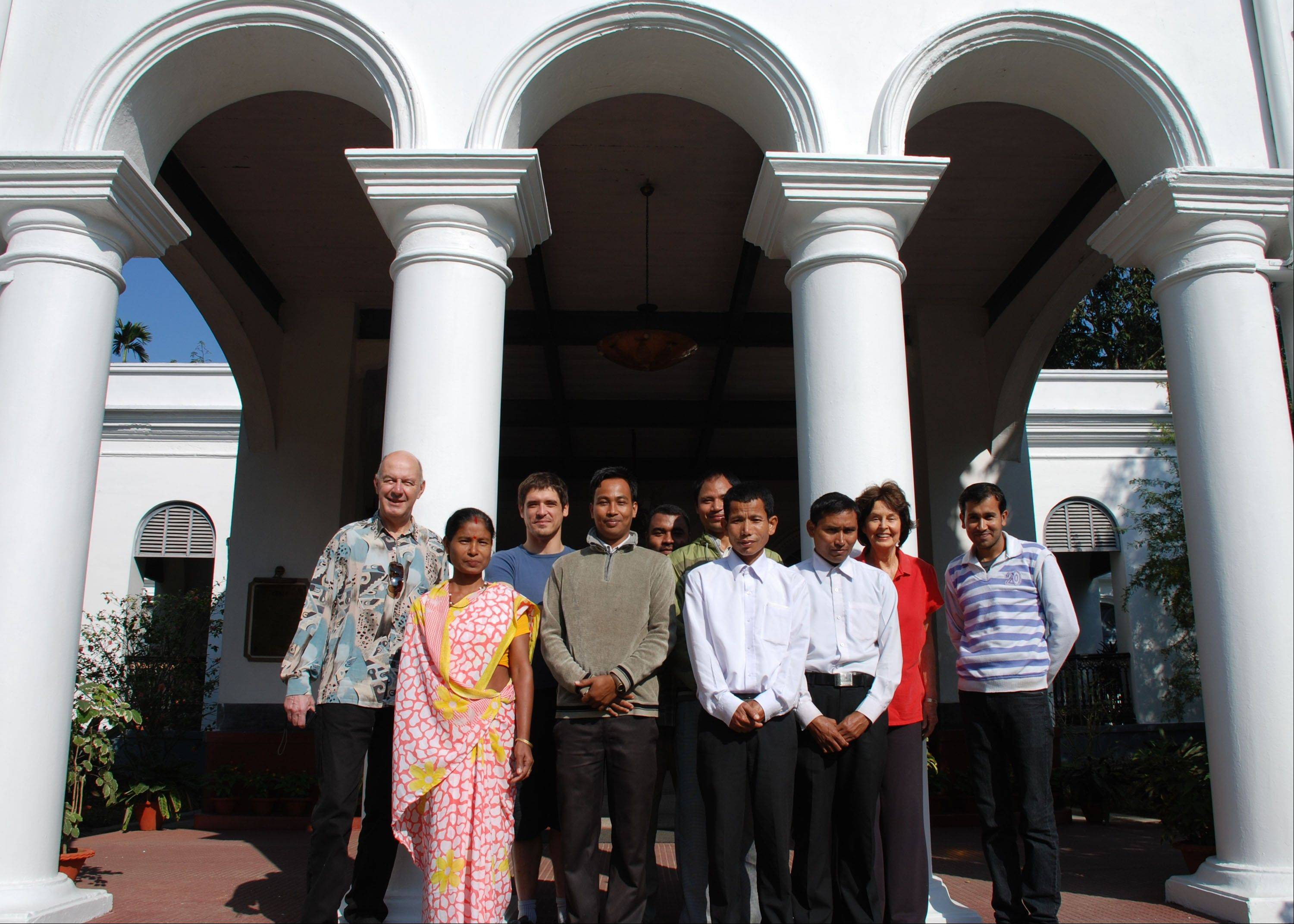 Guests and staff members poised at the entrance of Thengal Manor, gracious home of the Barooah tea dynasty, which is now open to tourists in Jorhat, India.