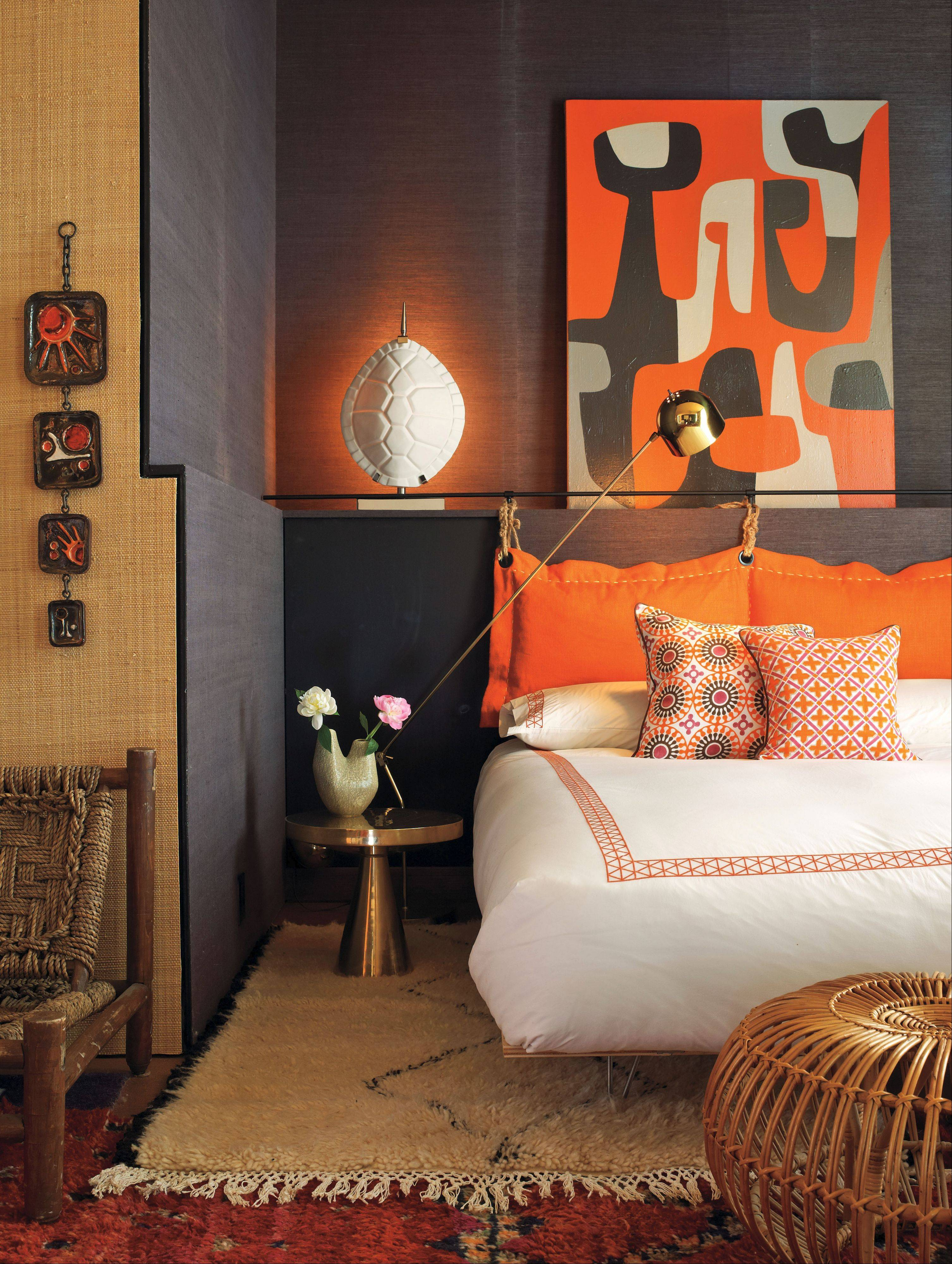 Orange plays a part in the decor at the home of Jonathan Adler and Simon Doonan year-round.