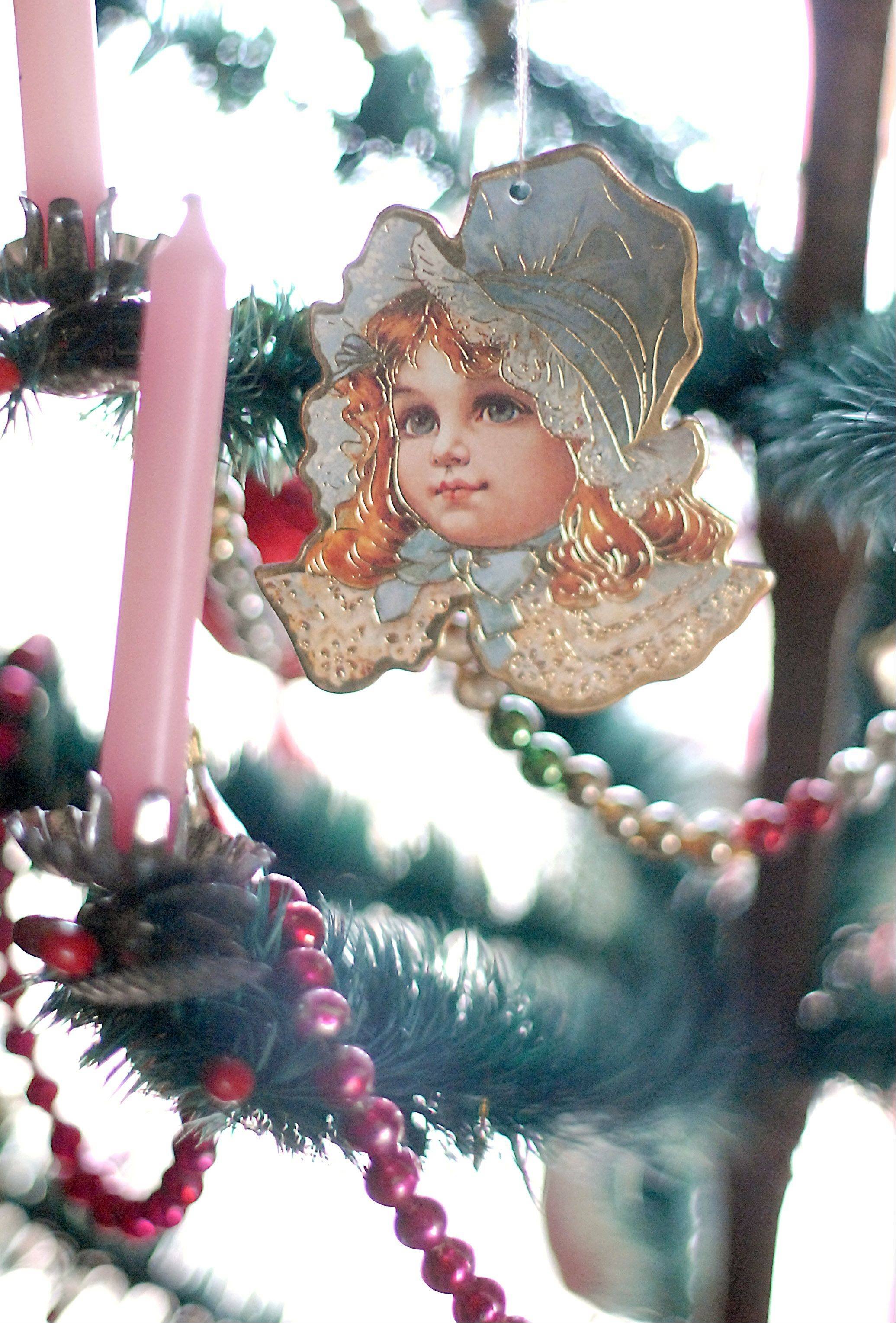 Paper ornaments hang from a Victorian Christmas tree at Kline Creek Farm in West Chicago on Sunday.