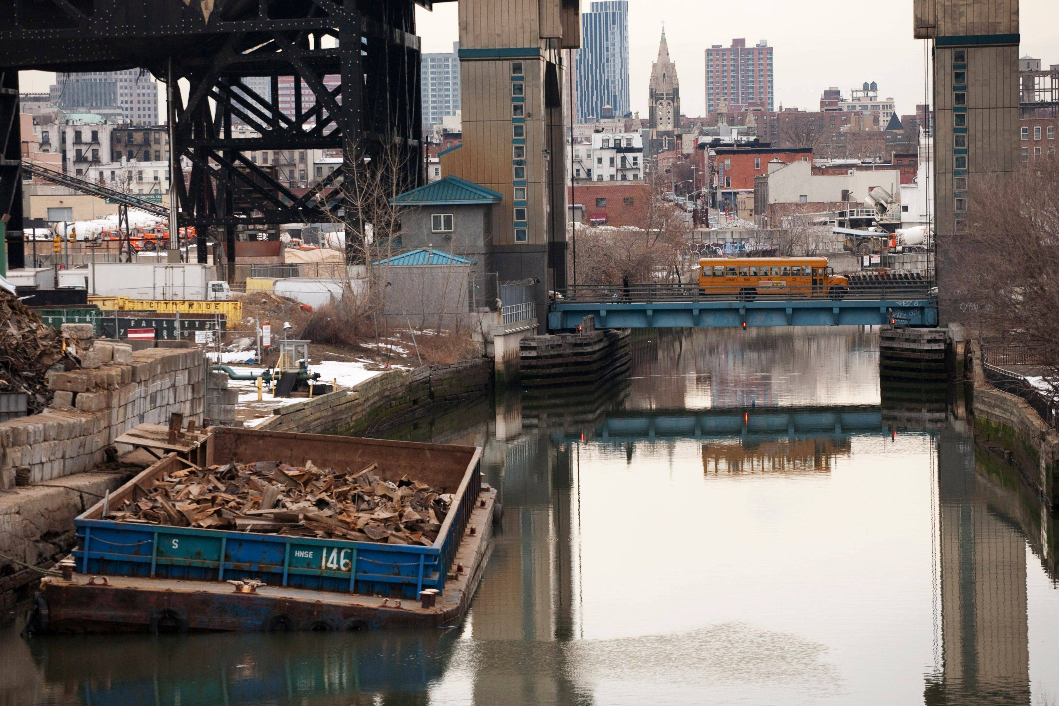 This file photo of March 2, 2010 shows the Gowanus Canal, which was added to the Superfund National Priorities List in 2010 for being heavily contaminated with PCBs, heavy metals, volatile organics and coal tar wastes. New York, New Jersey and EPA officials say toxic sites are OK after Superstorm Sandy, but The Associated Press has found that few actual tests have been done.