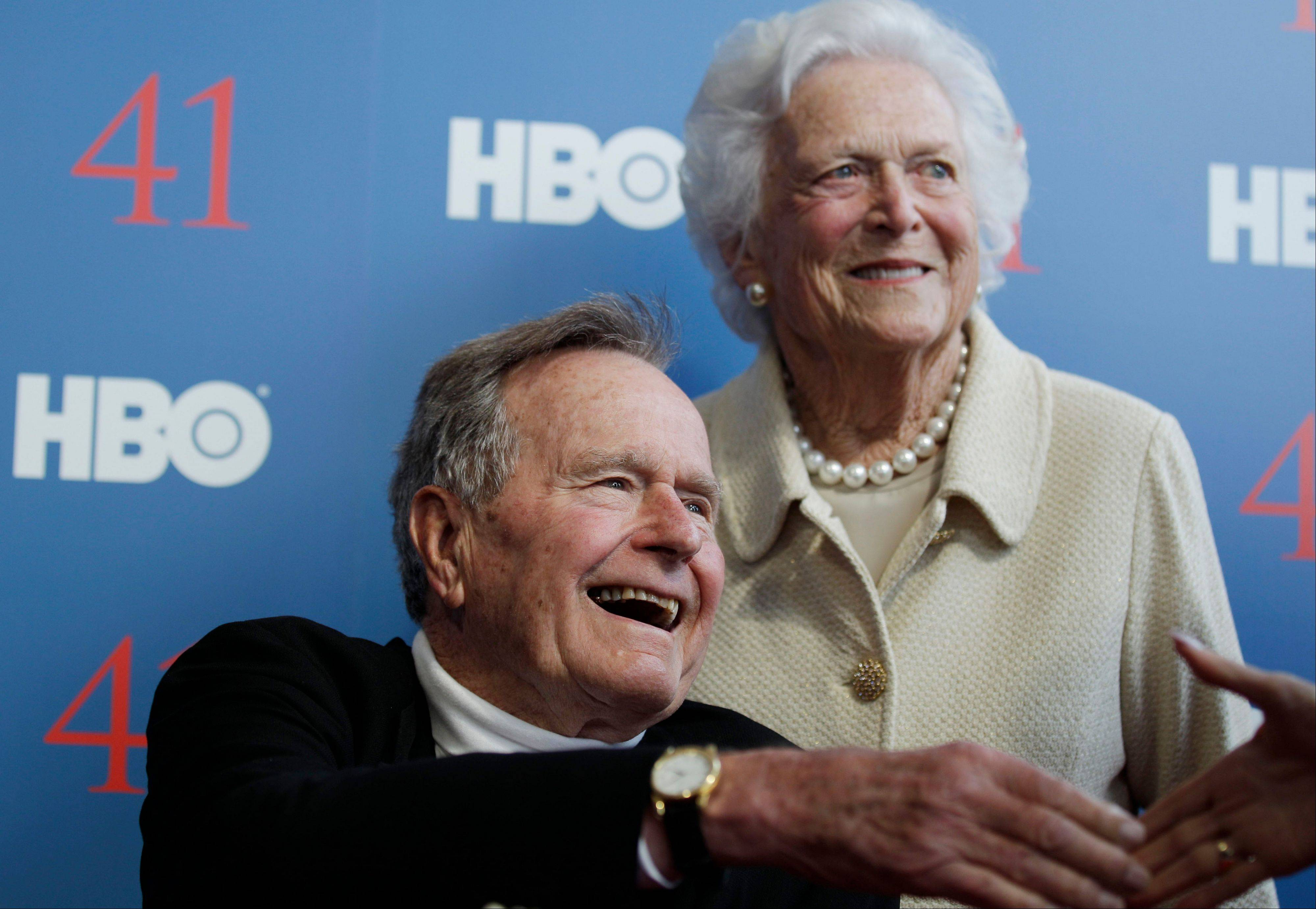 In a Tuesday, June 12, 2012 file photo, former President George H.W. Bush, and his wife former first lady Barbara Bush, arrive for the premiere of HBO's new documentary on his life near the family compound in Kennebunkport, Maine. The 41st president's monthlong stay in a Houston hospital for treatment of a bronchitis-related cough appears to be nearing an end.