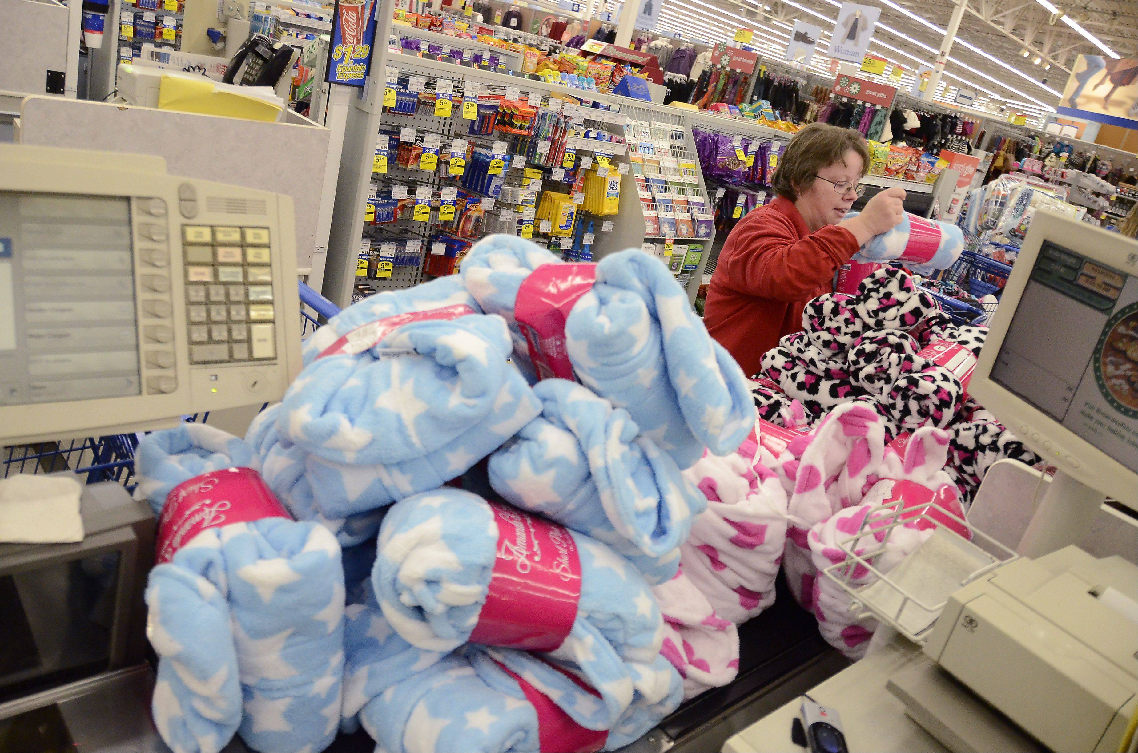 Toys from Daily Herald Hope for the Holidays campaign load up the checkout at the Meijer store in Rolling Meadows.