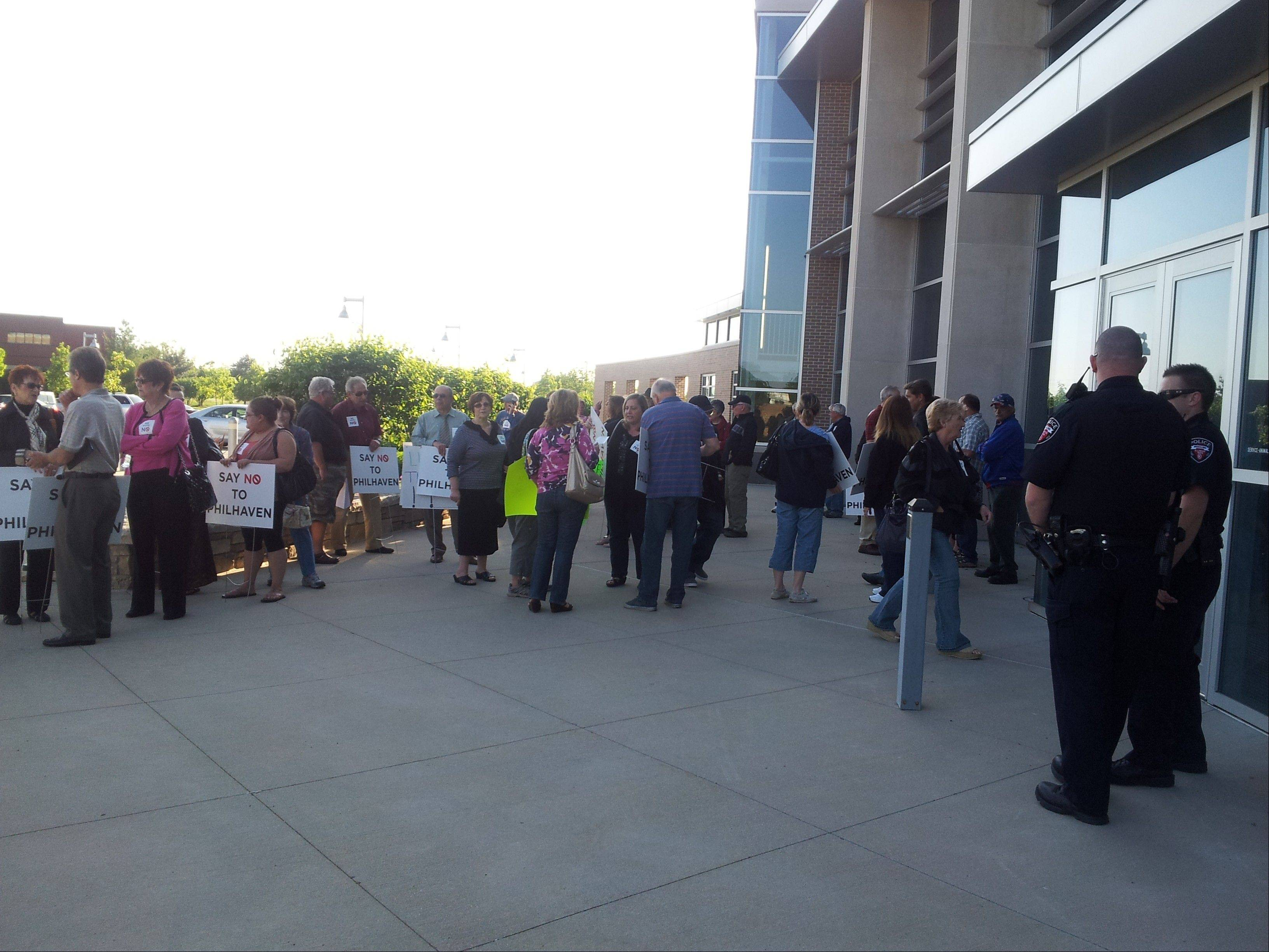 A group of residents opposing the Philhaven development gather outside the Wheeling village board meeting last May.