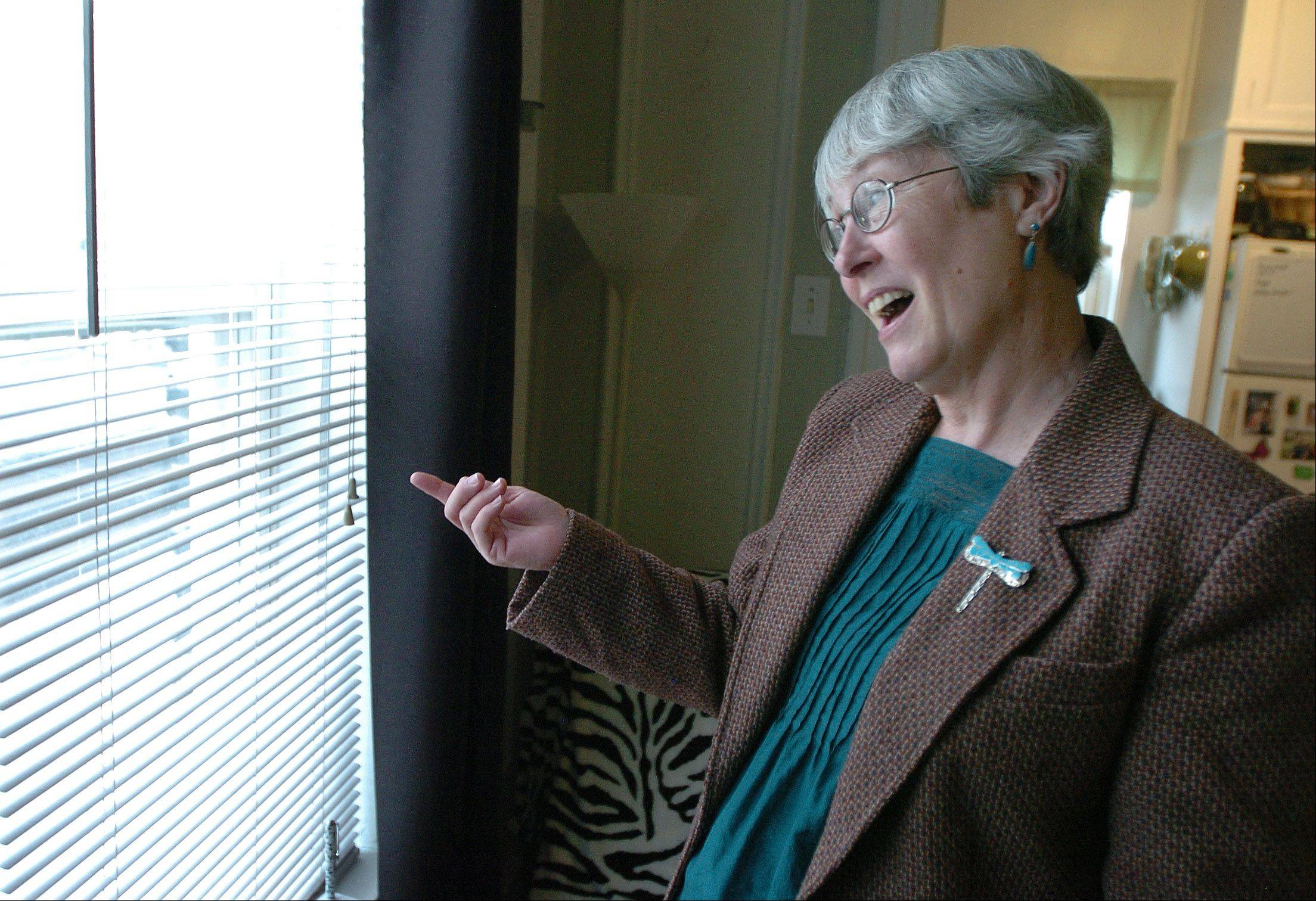 Stephanie Brown, living in a supportive housing apartment in Evanston, looks outside her window.