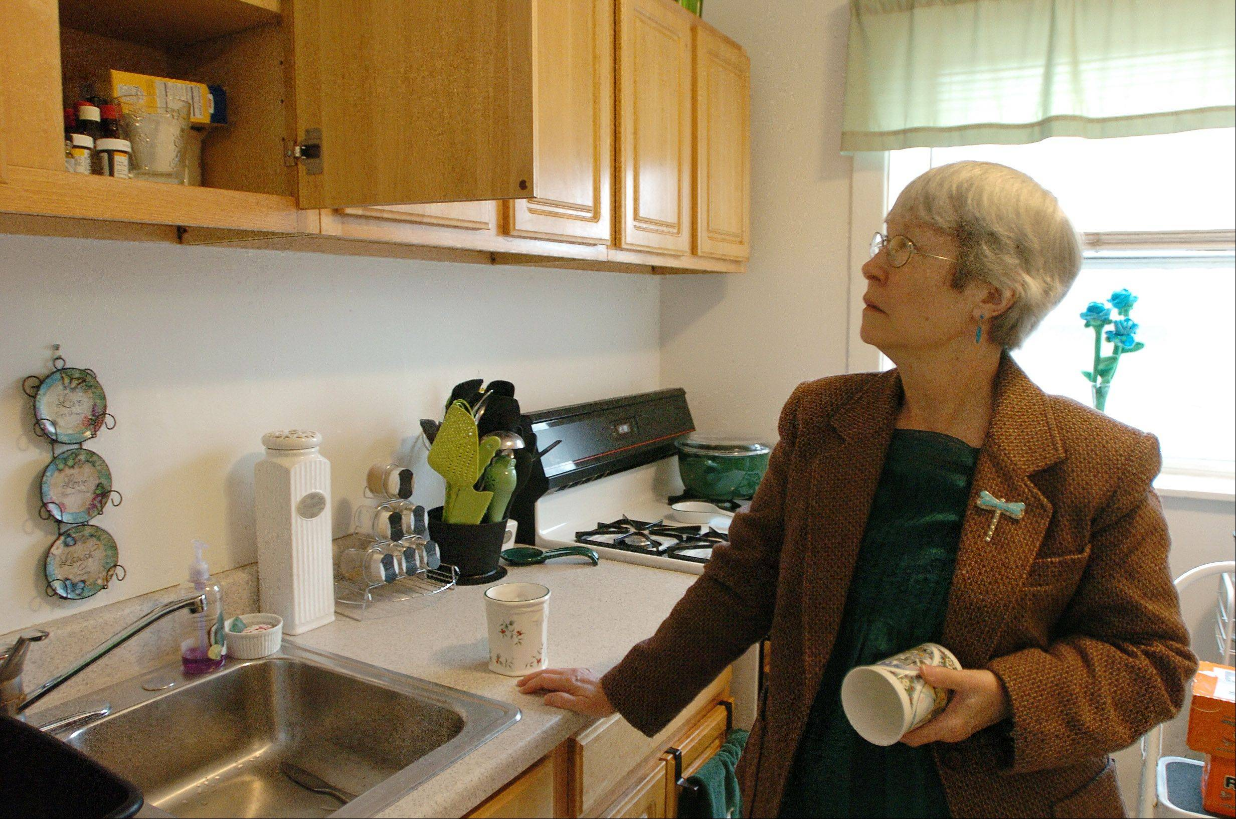 Stephanie Brown, in her kitchen, lives in a supportive housing apartment in Evanston.