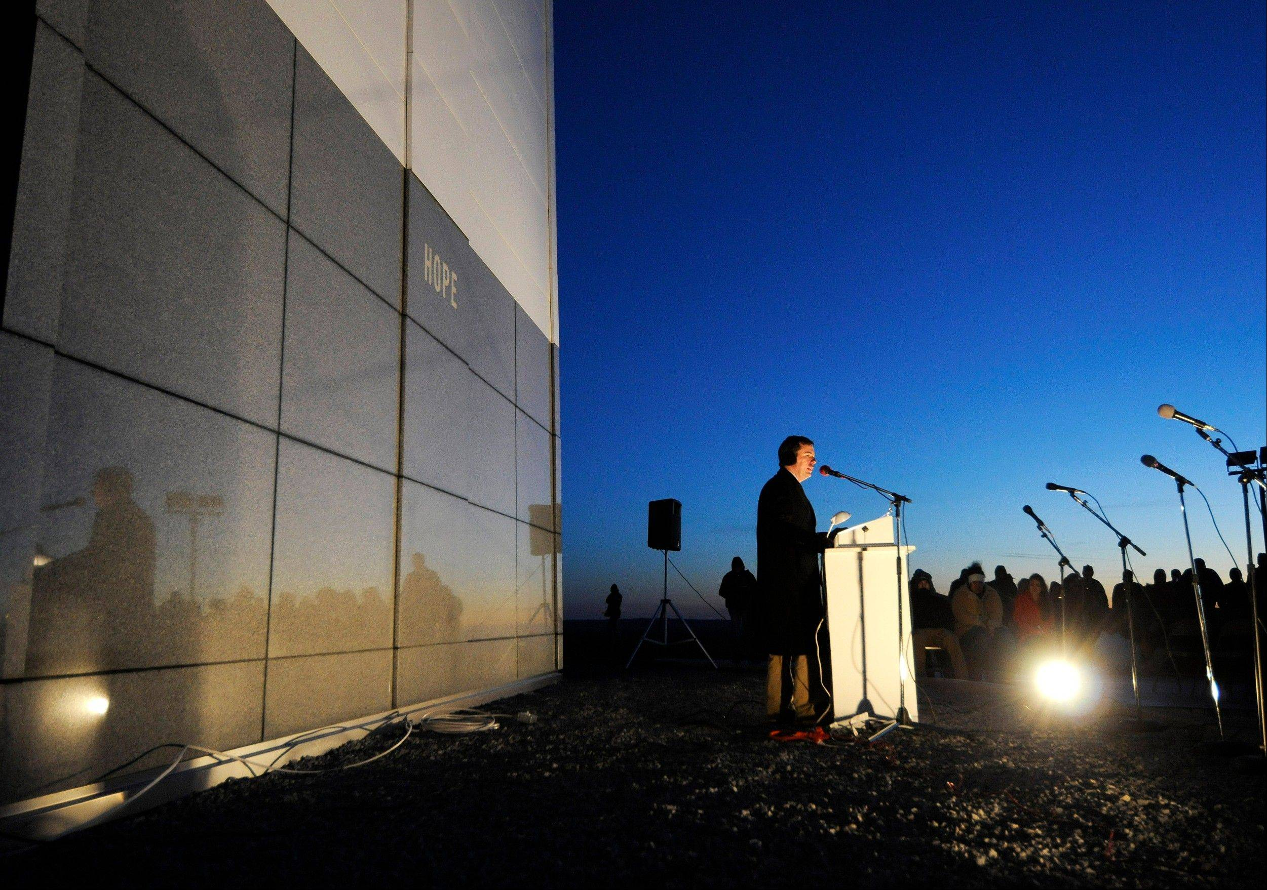 D.W. Presley, president of the Bald Knob Cross of Peace, addresses the crowd before four LED light panels are turned on to illuminate the cross Saturday in downstate Alto Pass. The lighting ceremony marked the completion of a renovation project that began in 2009.