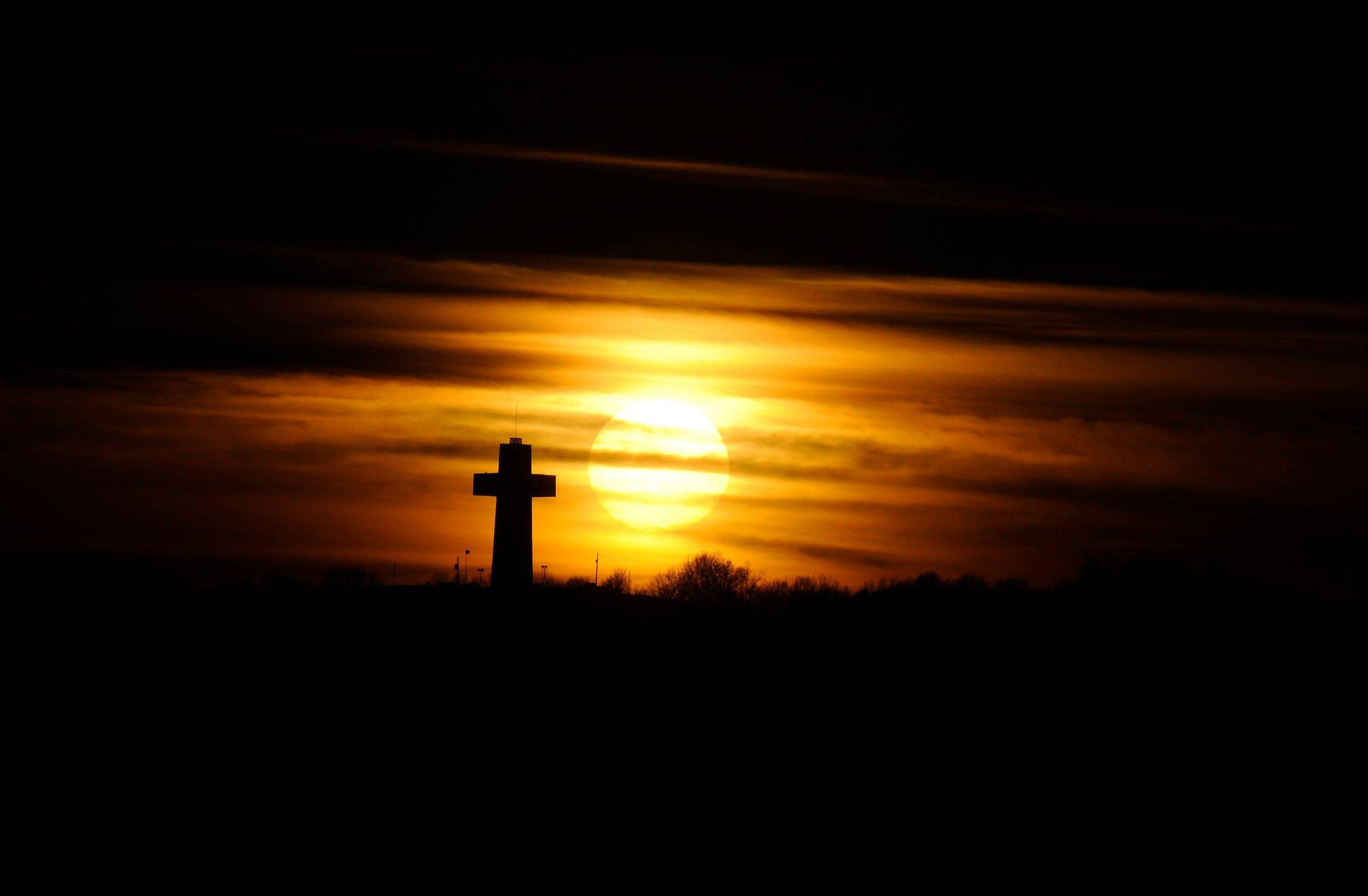 The sun sets behind the Bald Knob Cross of Peace in downstate Alto Pass. A lighting ceremony at the landmark marked on Saturday marked the completion of a renovation project that started in 2009.