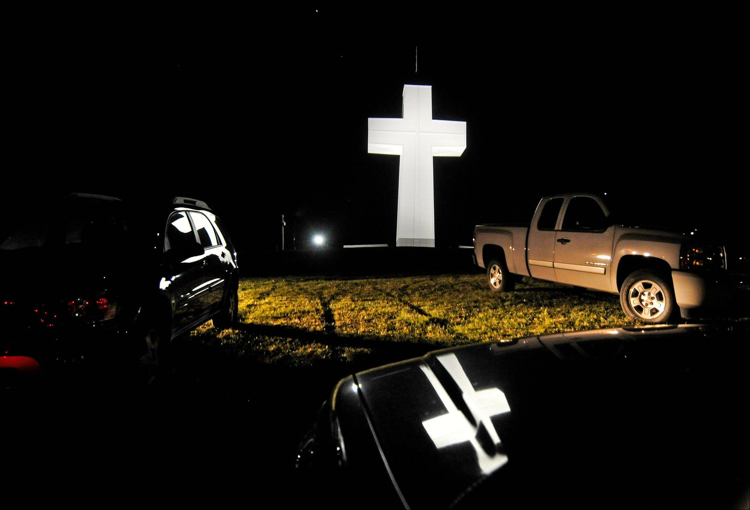 Vehicles begin to clear the hillside after a lighting ceremony Saturday at the Bald Knob Cross of Peace in downstate Alto Pass. The lighting ceremony marked the completion of a renovation project that began in 2009.