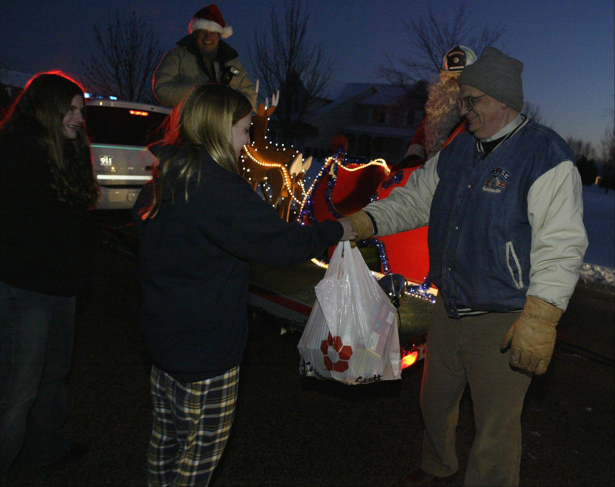 Santa and the Gilberts Fire Department collect donations during a previous Santa Run. The local tradition, sponsored by the Rutland Dundee Firefighters' Association, has been going on for 40 years.