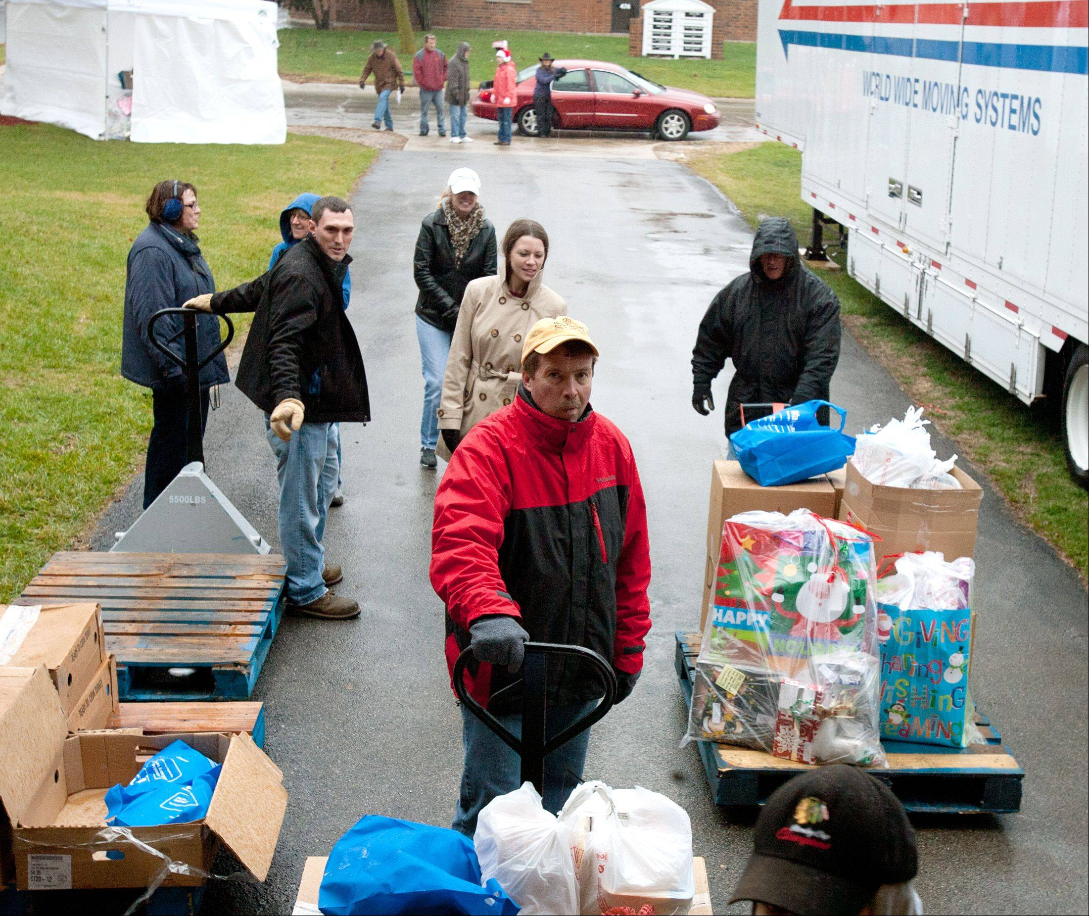 The Carol Stream-based Humanitarian Service Project provided holiday packages for more than 150 families in need this year.