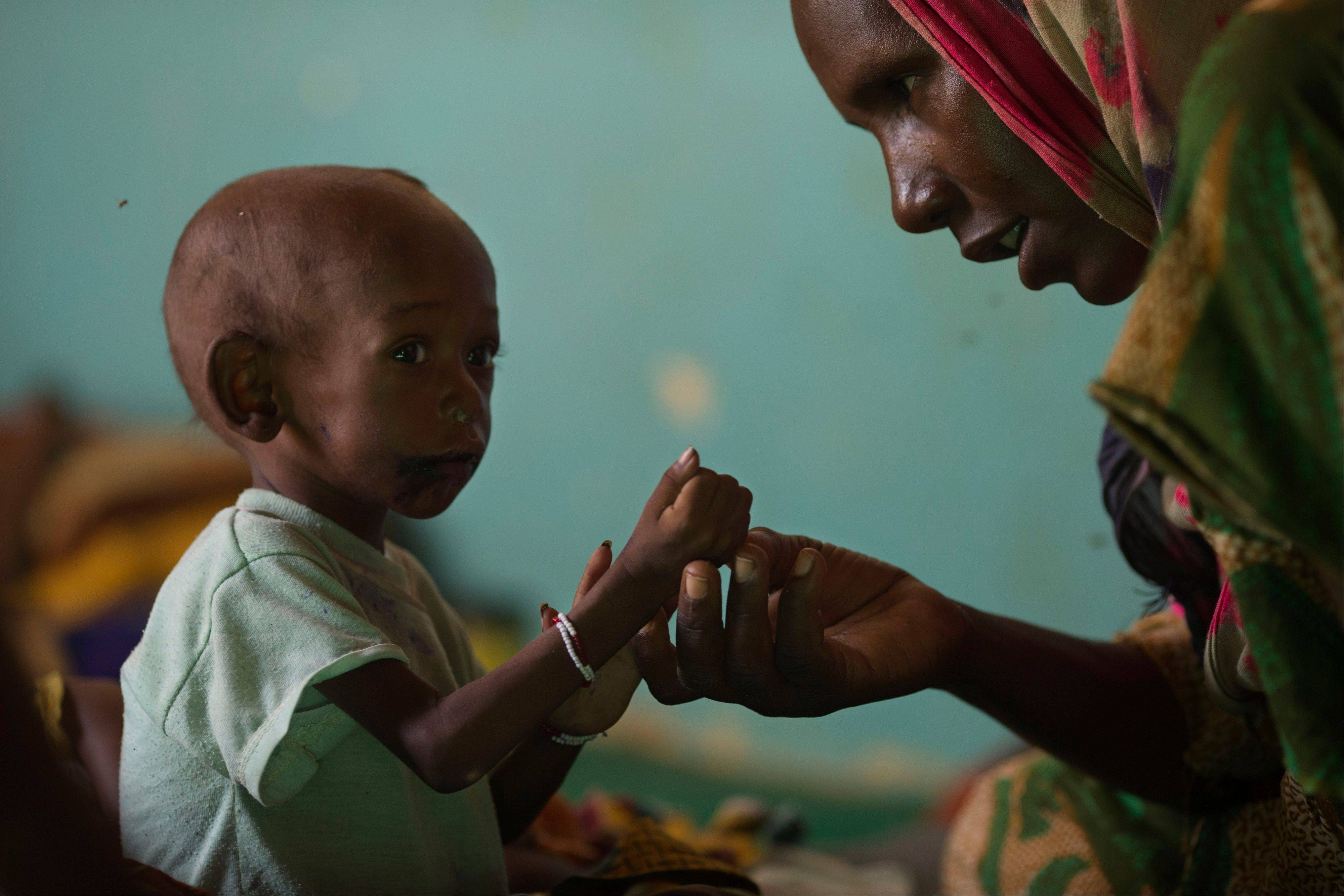 Zara Seid talks to her daughter Fatime Mahamat, 3, who is being treated for severe malnutrition at a nutritional health clinic run by Action Against Hunger with the support of UNICEF, in Mao, Chad. In this Sahel nation, childhood malnutrition and related mortality persist at alarming rates, despite the fact that many affected families live within a day's journey of internationally-funded nutrition clinics.