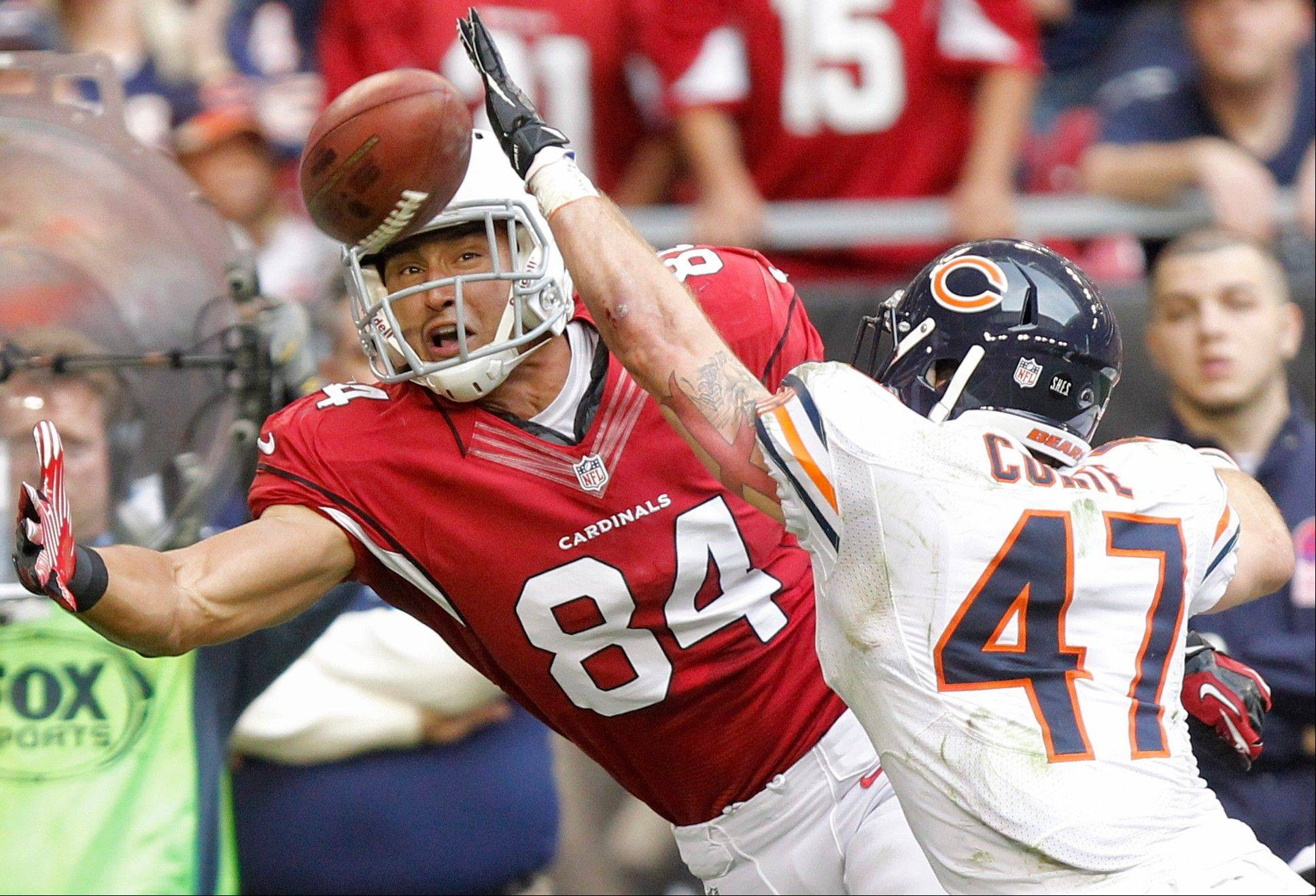 Arizona Cardinals tight end Rob Housler tries to pull in a pass as Chicago Bears free safety Chris Conte defends during the first half.