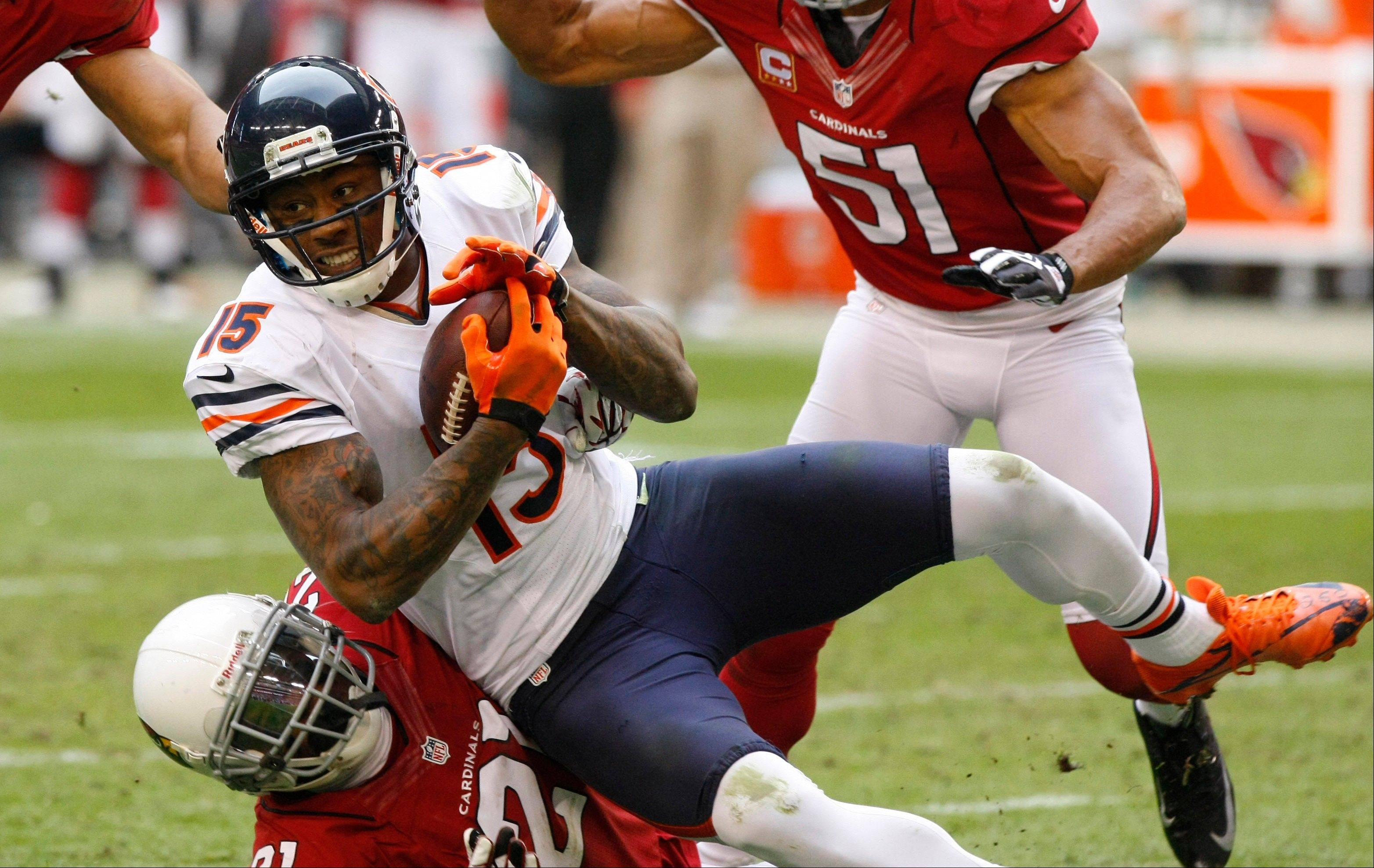 Chicago Bears wide receiver Brandon Marshall is tackled by Arizona Cardinals cornerback Patrick Peterson during the first half.