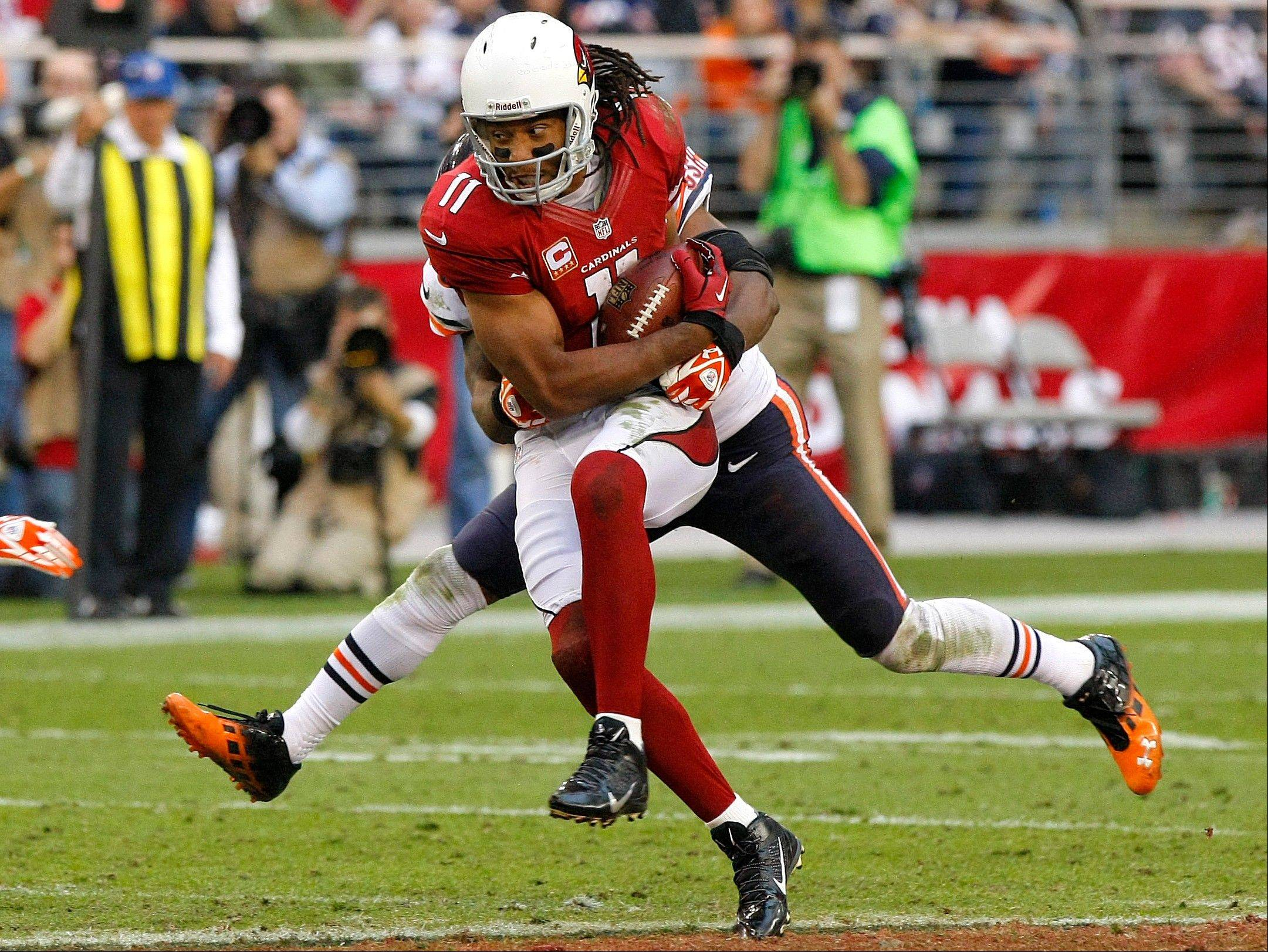 Arizona Cardinals wide receiver Larry Fitzgerald pulls in a pass against the Chicago Bears during the second half.