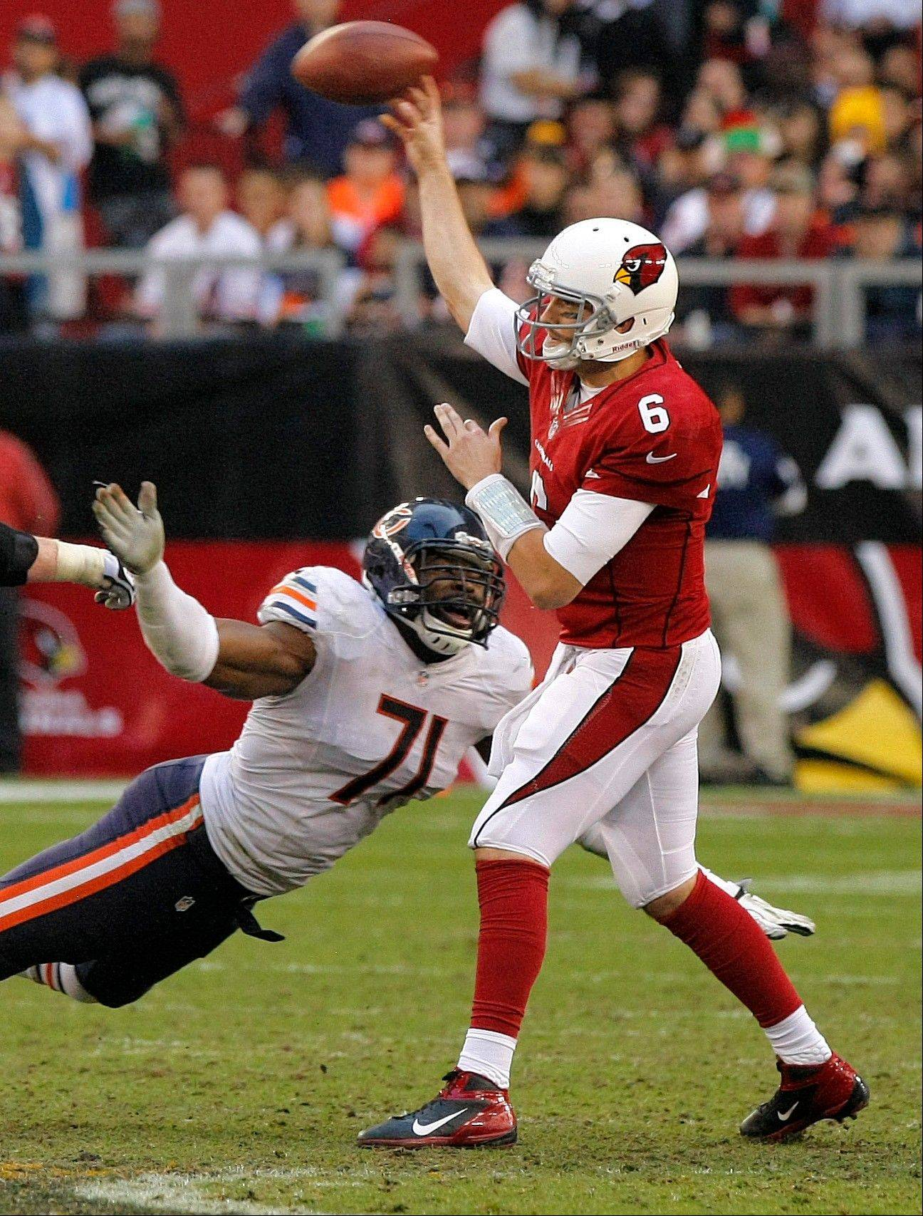 Arizona Cardinals quarterback Brian Hoyer is pressured by Chicago Bears defensive end Israel Idonije (71) during the second half.