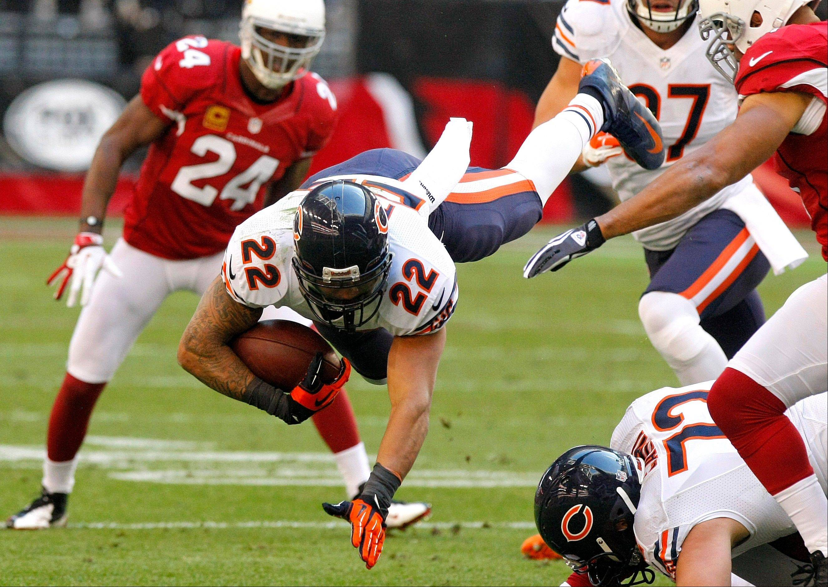Chicago Bears running back Matt Forte is tripped up against the Arizona Cardinals during the first half.