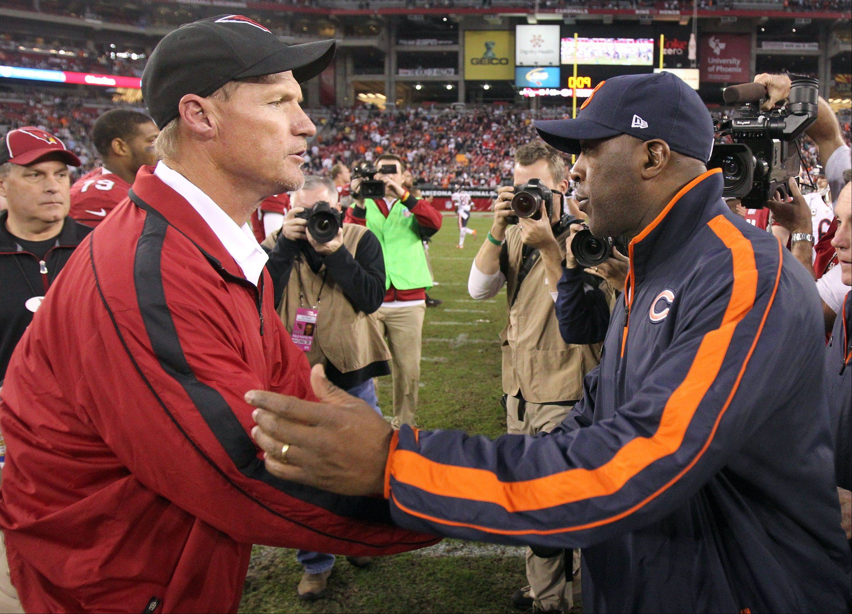 Arizona Cardinals coach Ken Whisenhunt, left, shakes hands with Chicago Bears coach Lovie Smith, right, following an NFL football game. The Bears won 28-13.