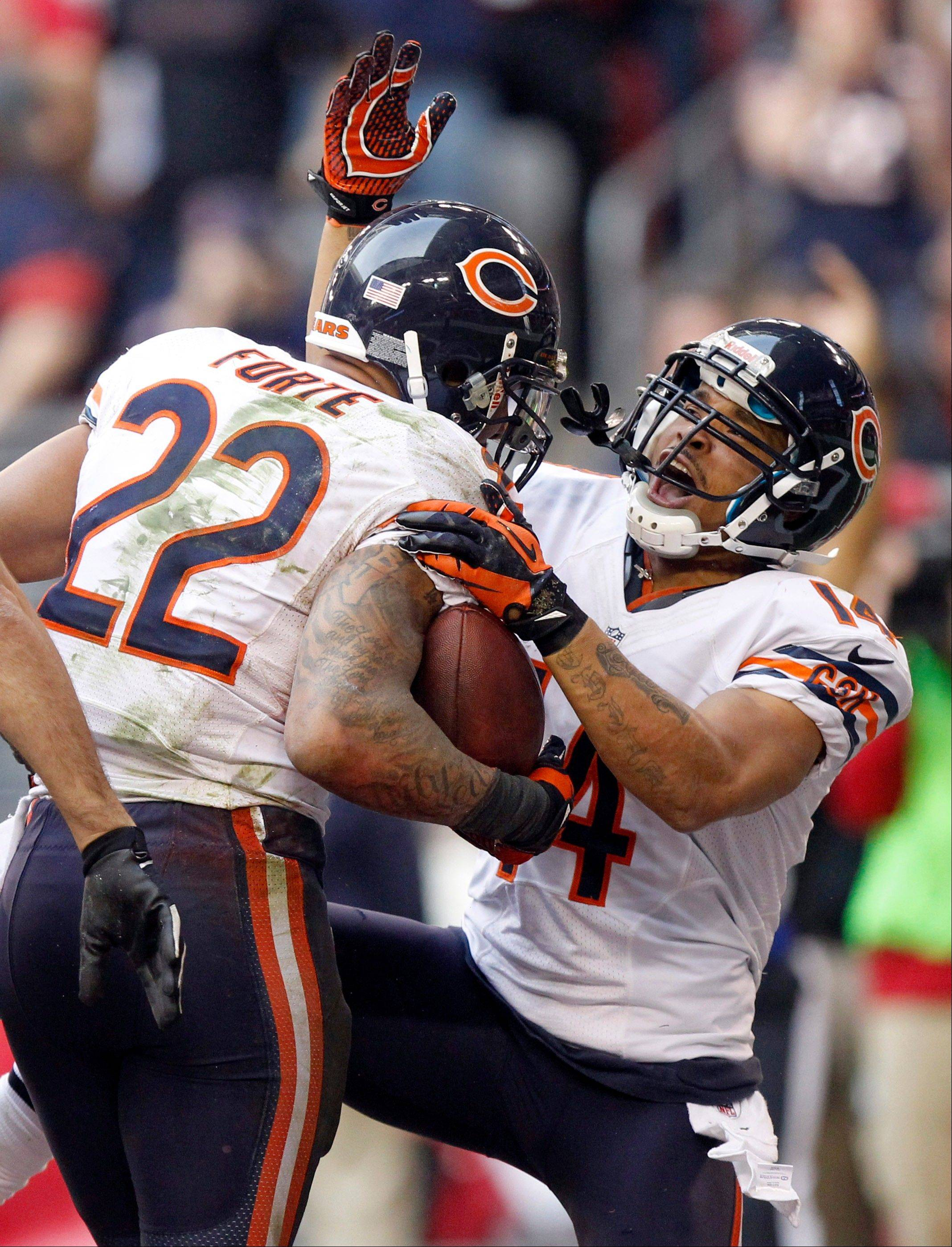 Chicago Bears running back Matt Forte celebrates his touchdown with teammate Eric Weems against the Arizona Cardinals during the first half.