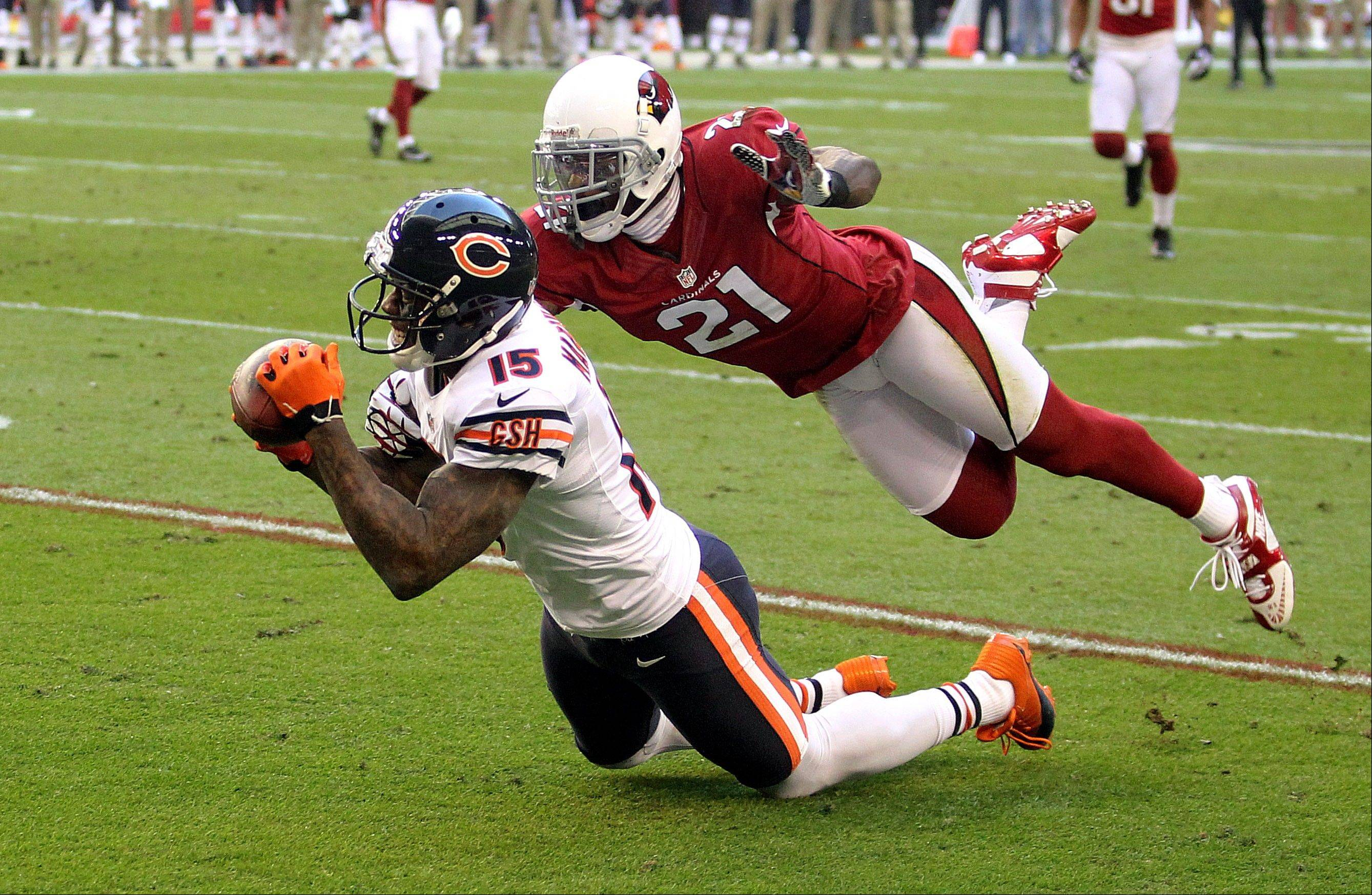 Chicago Bears wide receiver Brandon Marshall can't hold onto the pass as Arizona Cardinals cornerback Patrick Peterson defends during the first half.
