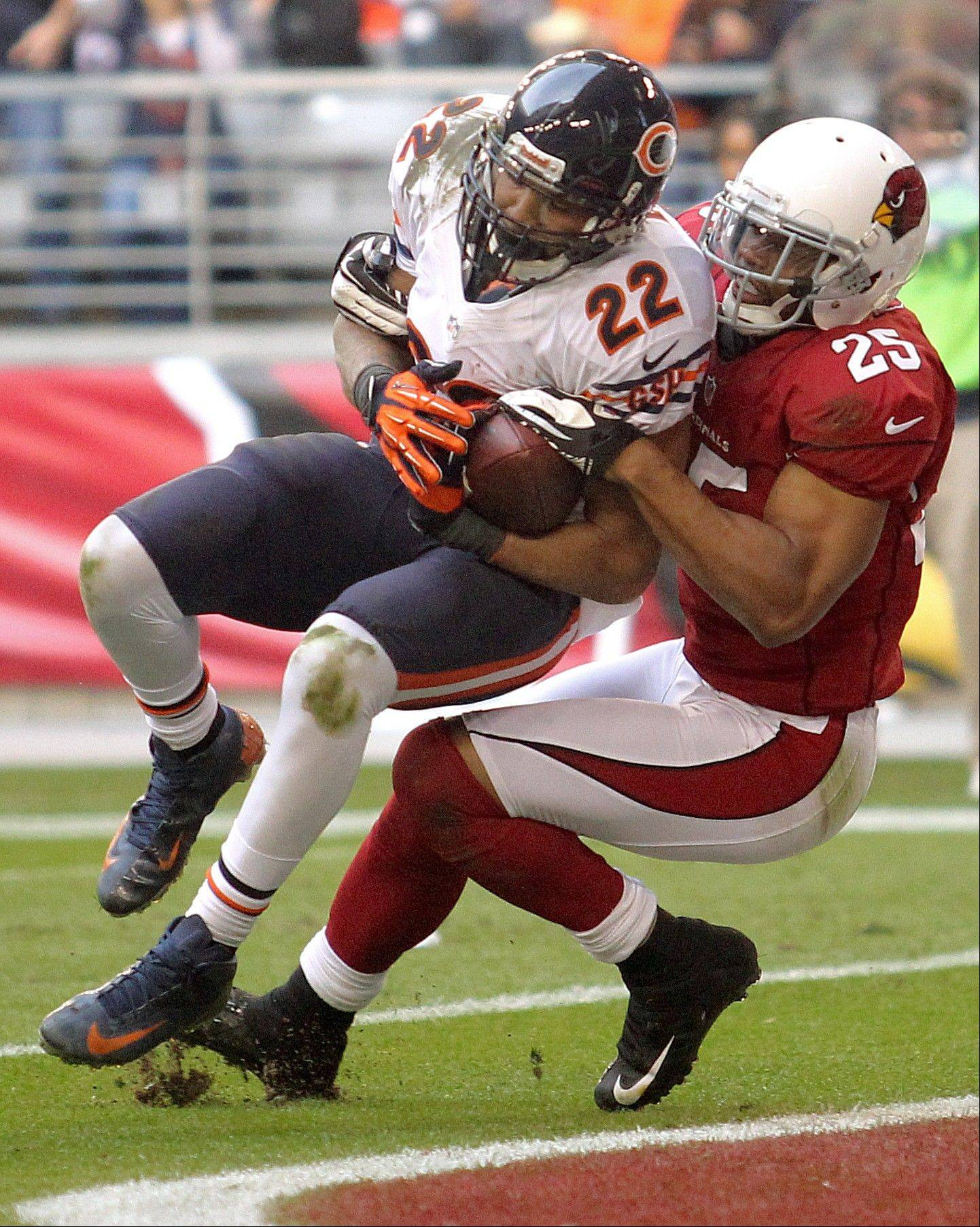 Chicago Bears running back Matt Forte scores a touchdown as Arizona Cardinals free safety Kerry Rhodes defends during the first half.