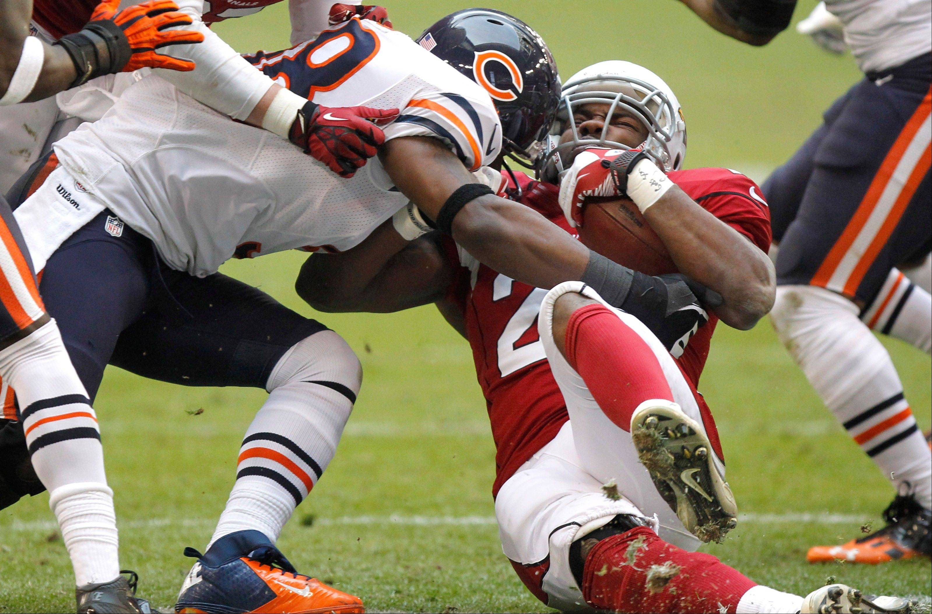 Arizona Cardinals running back Alfonso Smith is hit by Chicago Bears outside linebacker Geno Hayes, left, during the first half.