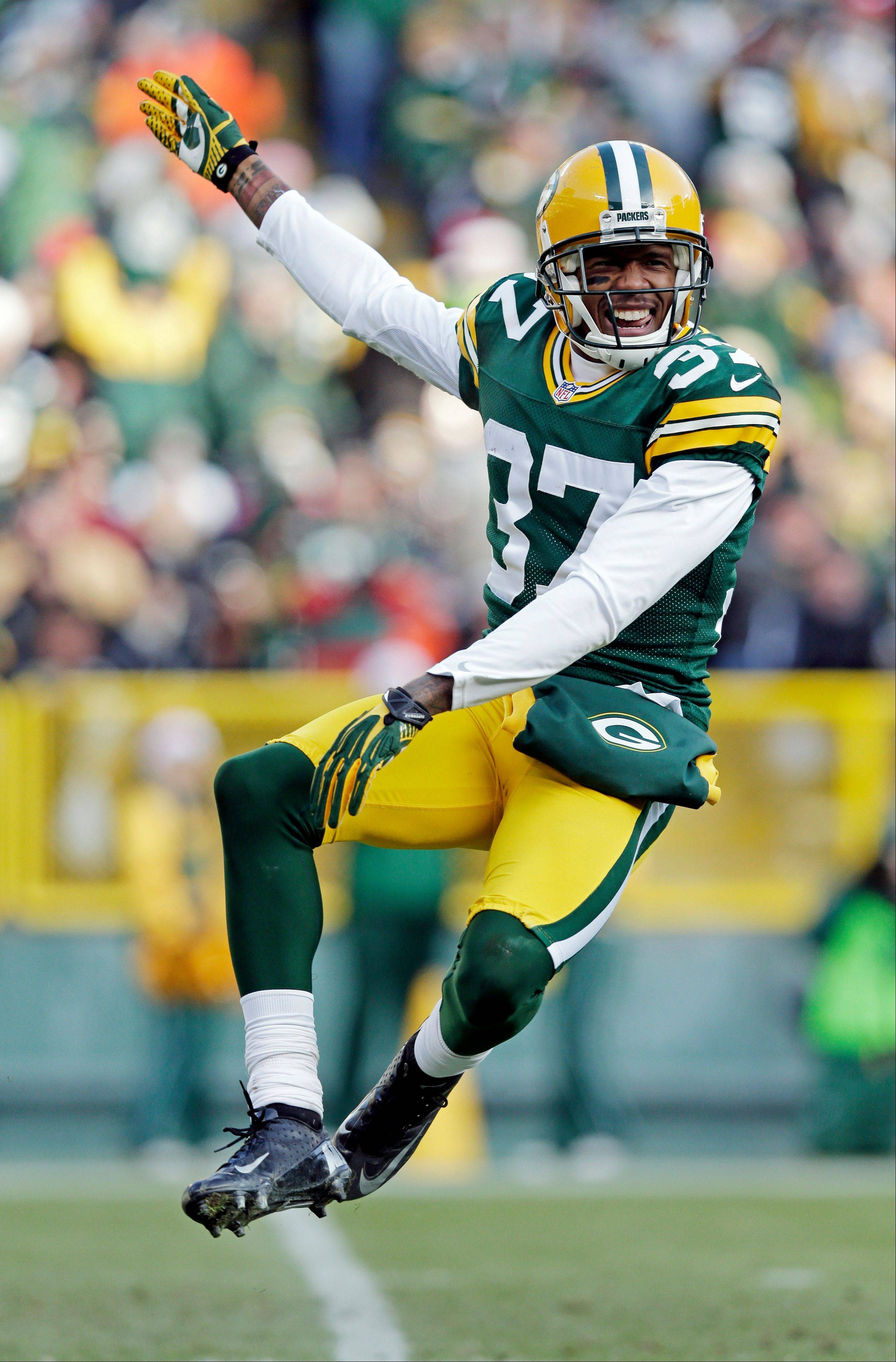 Green Bay Packers' Sam Shields reacts after sacking Tennessee Titans quarterback Jake Locker during the second half of an NFL football game Sunday, Dec. 23, 2012, in Green Bay, Wis.