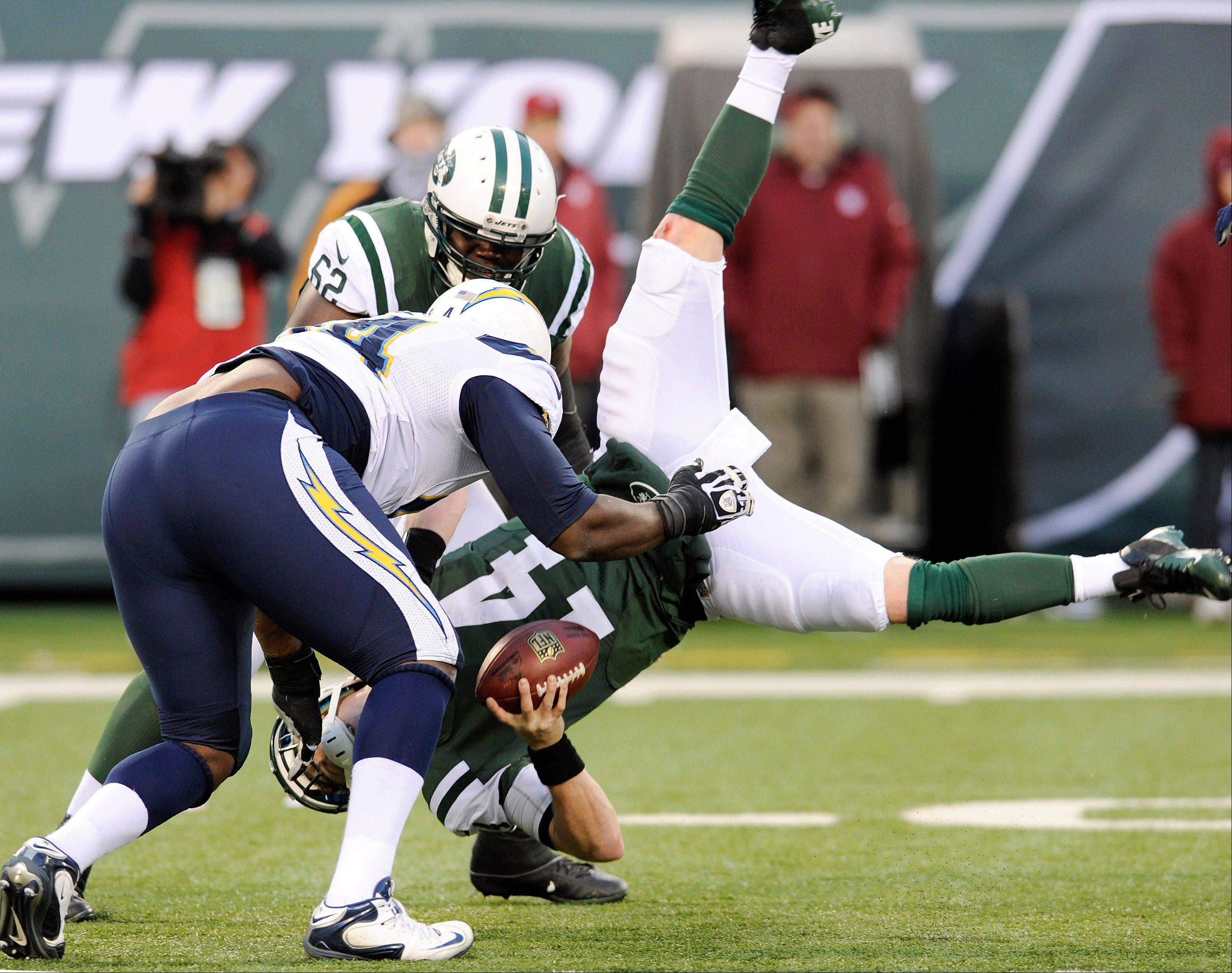 New York Jets quarterback Greg McElroy, bottom, is sacked by San Diego Chargers defensive end Corey Liuget, left, during the second half of an NFL football game on Sunday, Dec. 23, 2012, in East Rutherford, N.J. The Chargers won 27-17.