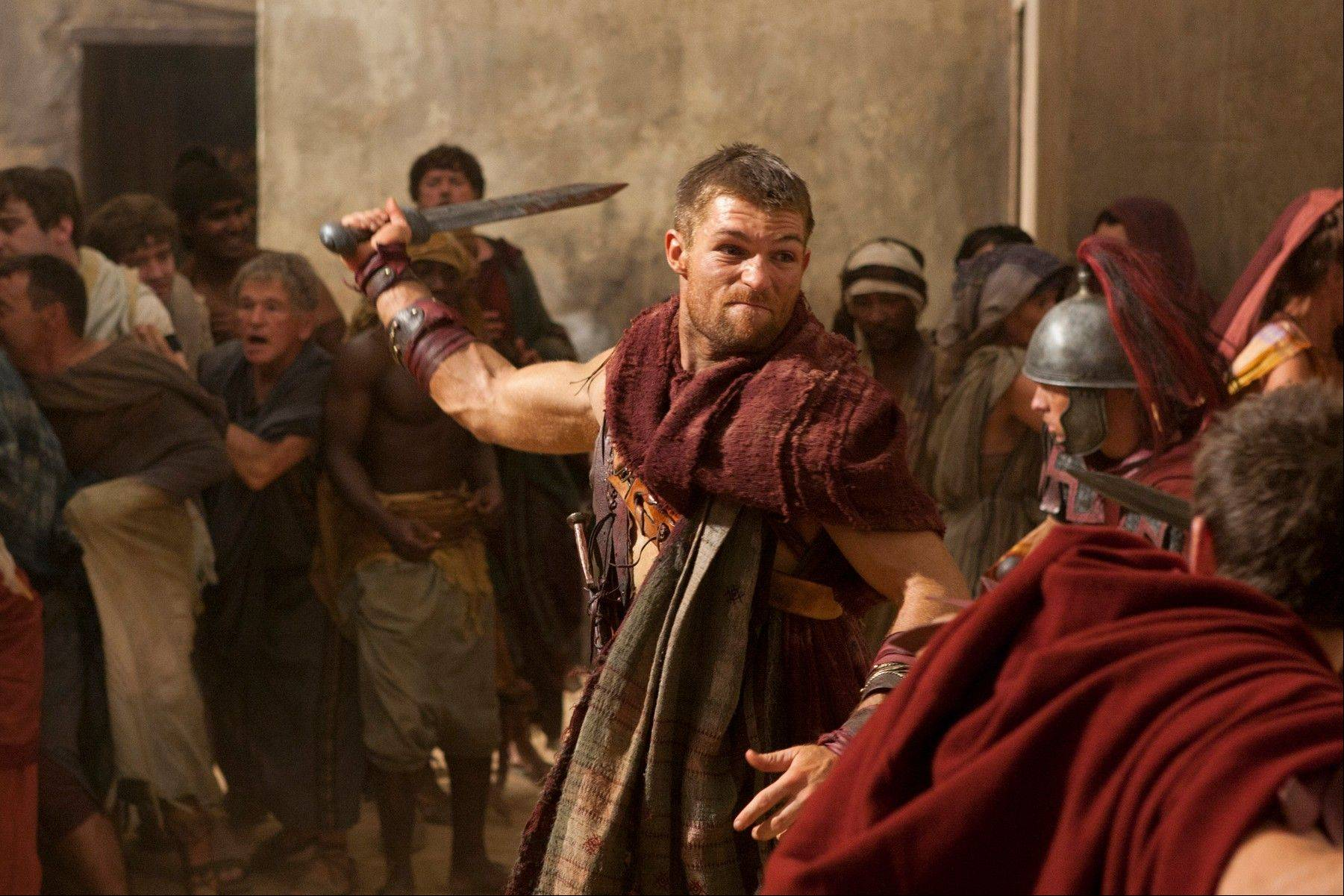 In this undated file image originally released by Starz, Liam McIntyre portrays the title role in a scene from �Spartacus: Vengeance,� airing on Starz. Starz will likely be sold.