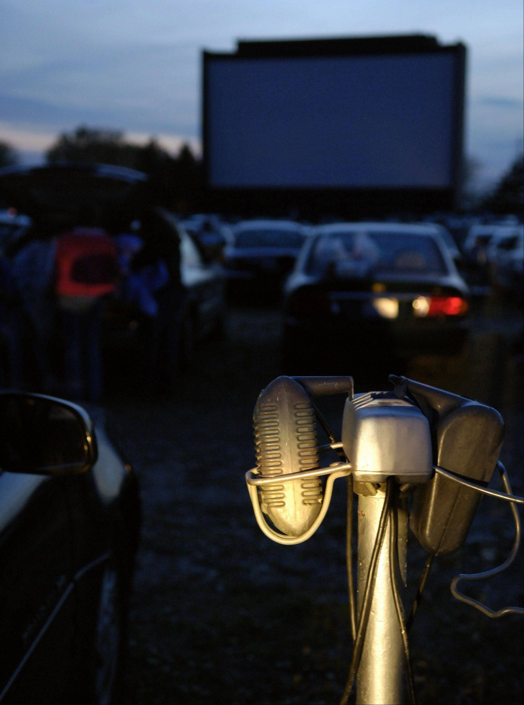 Drive-in movie theaters that scraped by during the surge in modern multiplexes are edging closer to extinction as Hollywood phases out the 35-millimeter reels they need to show films.