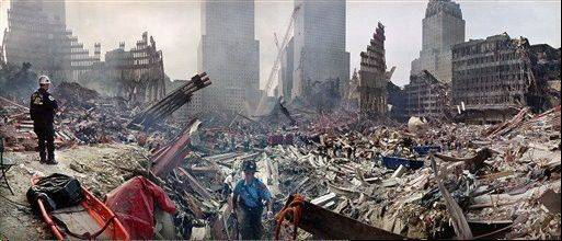Rescue workers examine the site of the Sept. 11, 2001, World Trade Center terrorist attacks in New York. The most comprehensive study of potential World Trade Center-related cancers raises more questions than it answers and won�t end a debate over whether the attacks were really a cause.