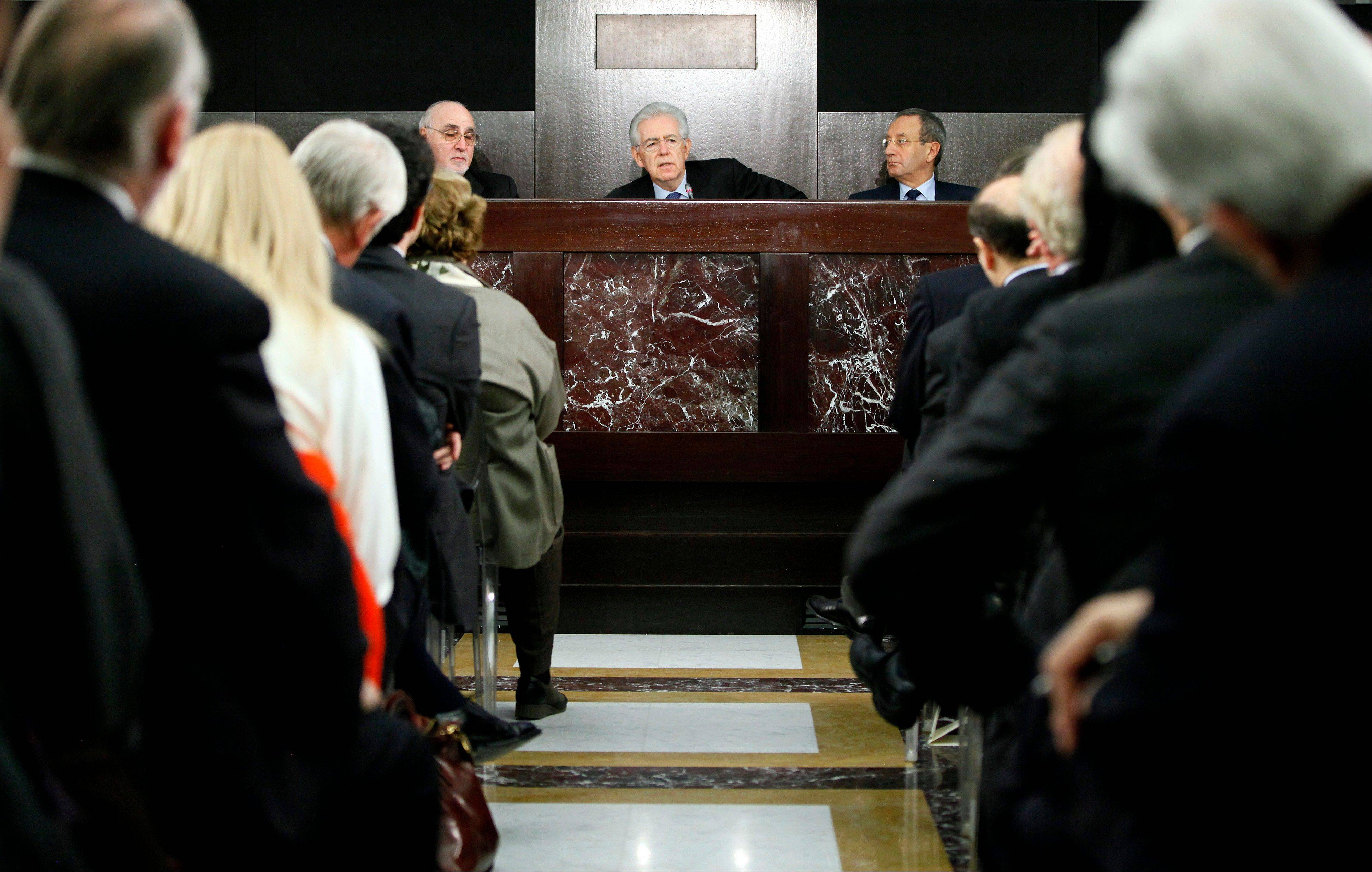 Mario Monti, Italy�s prime minister, center, speaks during his end-of-year news conference in Rome, Italy, on Sunday, Dec. 23, 2012. Monti said he won�t run in the country�s next elections, though he would agree to serve again as prime minister if a coalition backing his economic agenda won the vote.