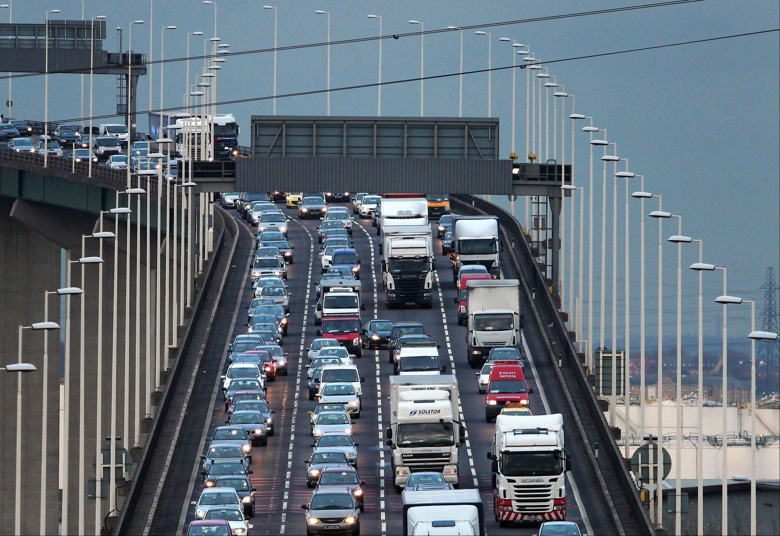 A general view of traffic crossing the Queen Elizabeth II Bridge across the River Thames at Dartford, south eastern England, as traffic builds up for the Christmas getaway.