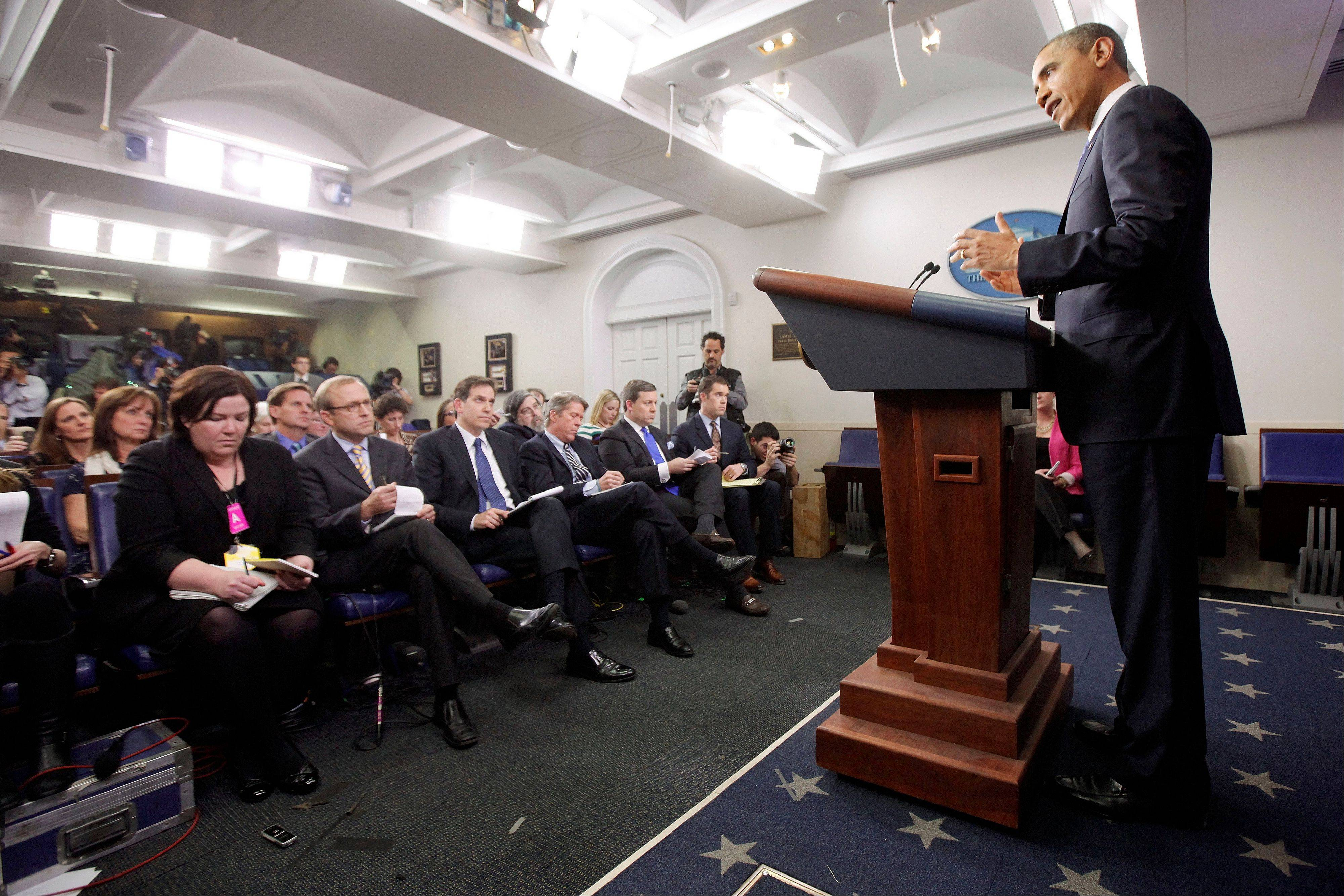 President Barack Obama speaks to reporters about the fiscal cliff in the Brady Press Briefing Room at the White House in Washington, Friday, Dec. 21, 2012.