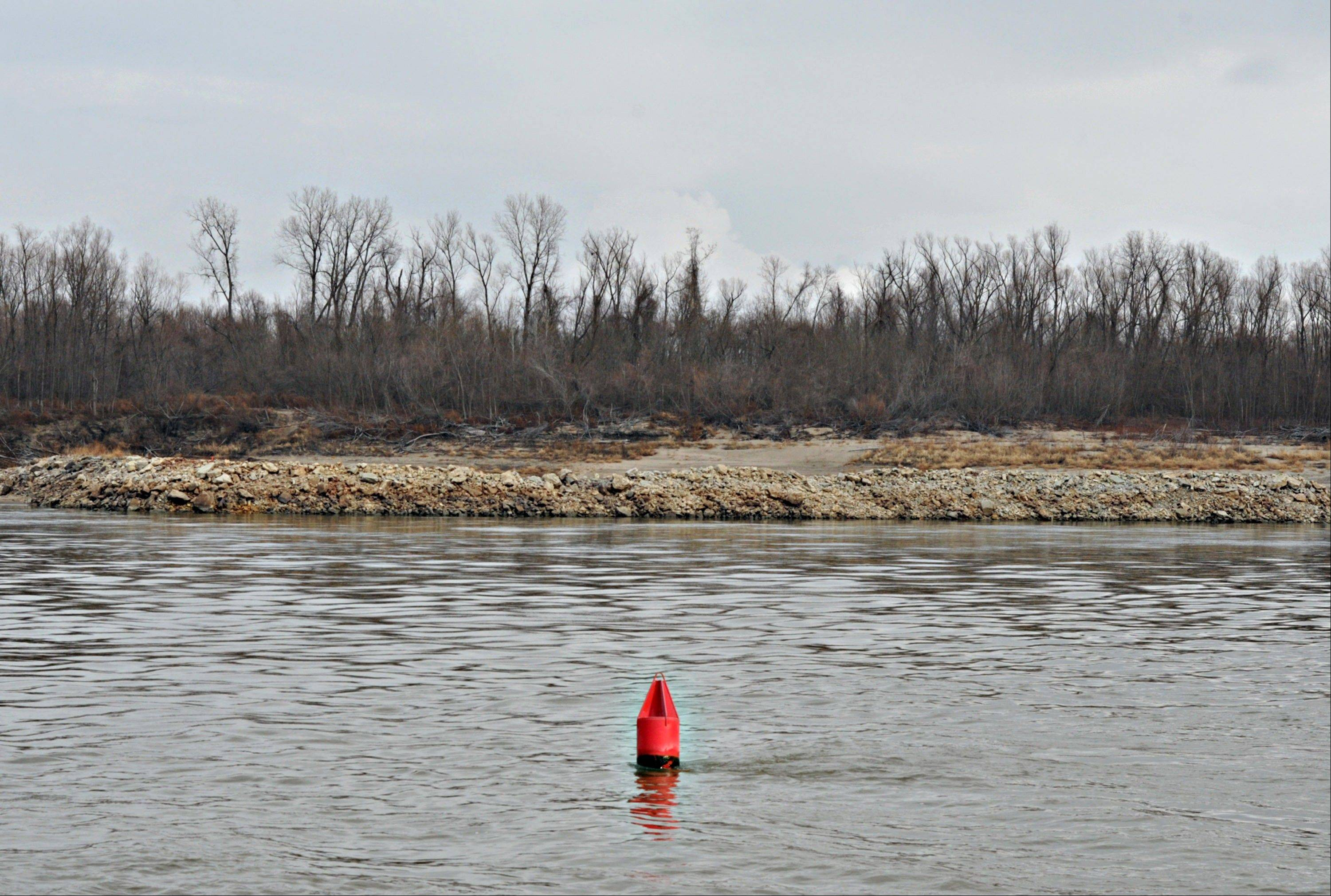 A floating buoy marks the edge of the shipping channel on the Mississippi River south of St. Louis, Missouri. Barges carrying grain, soybeans, coal, oil and other commodities on the Mississippi River have started to reduce their loads to navigate waters shrunk by the worst drought in 50 years.