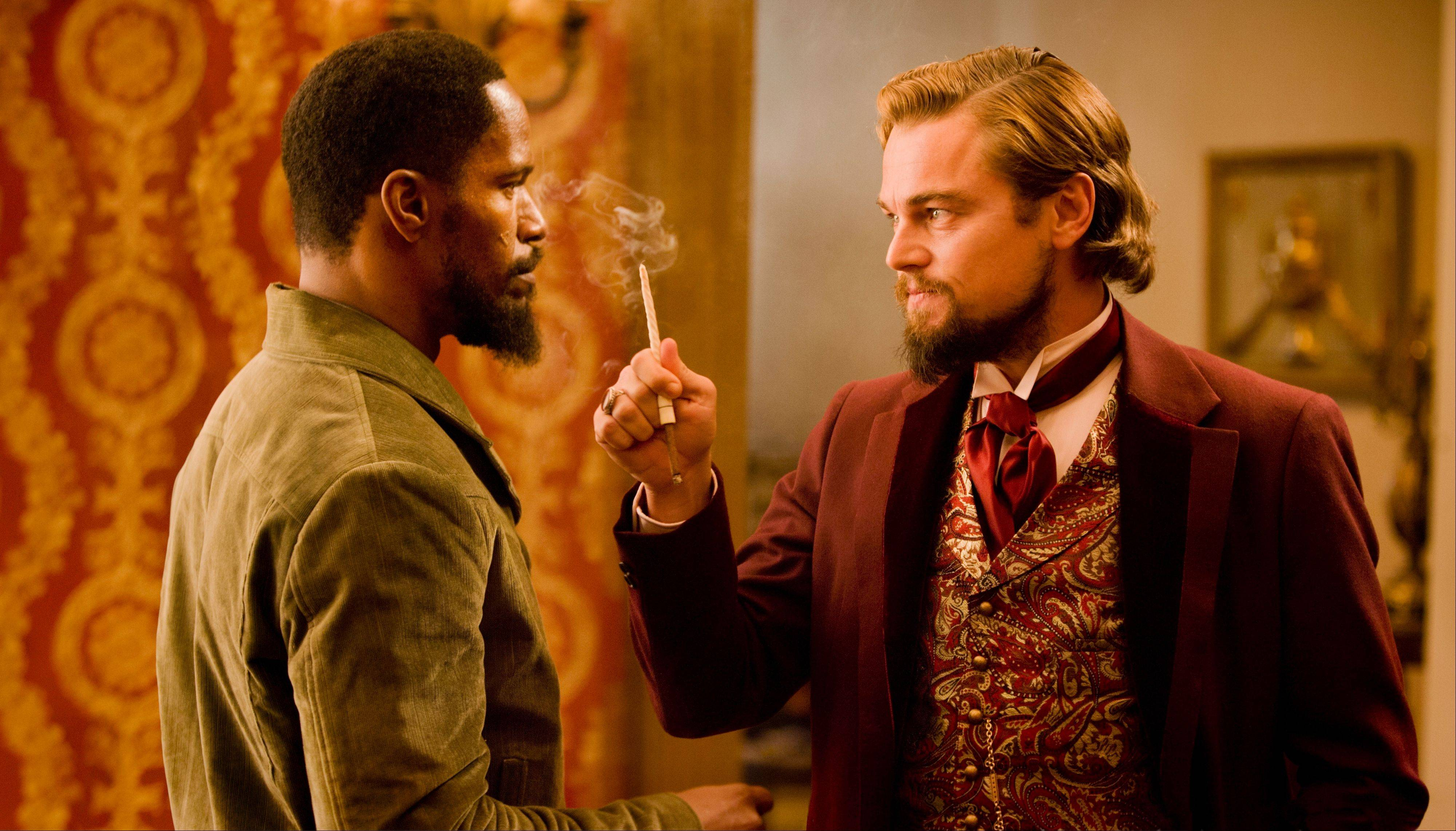 "A slave turned bounty hunter (Jamie Foxx) confronts plantation owner Calvin Candie (Leonardo DiCaprio) in Quentin Tarantino's ""Django."""