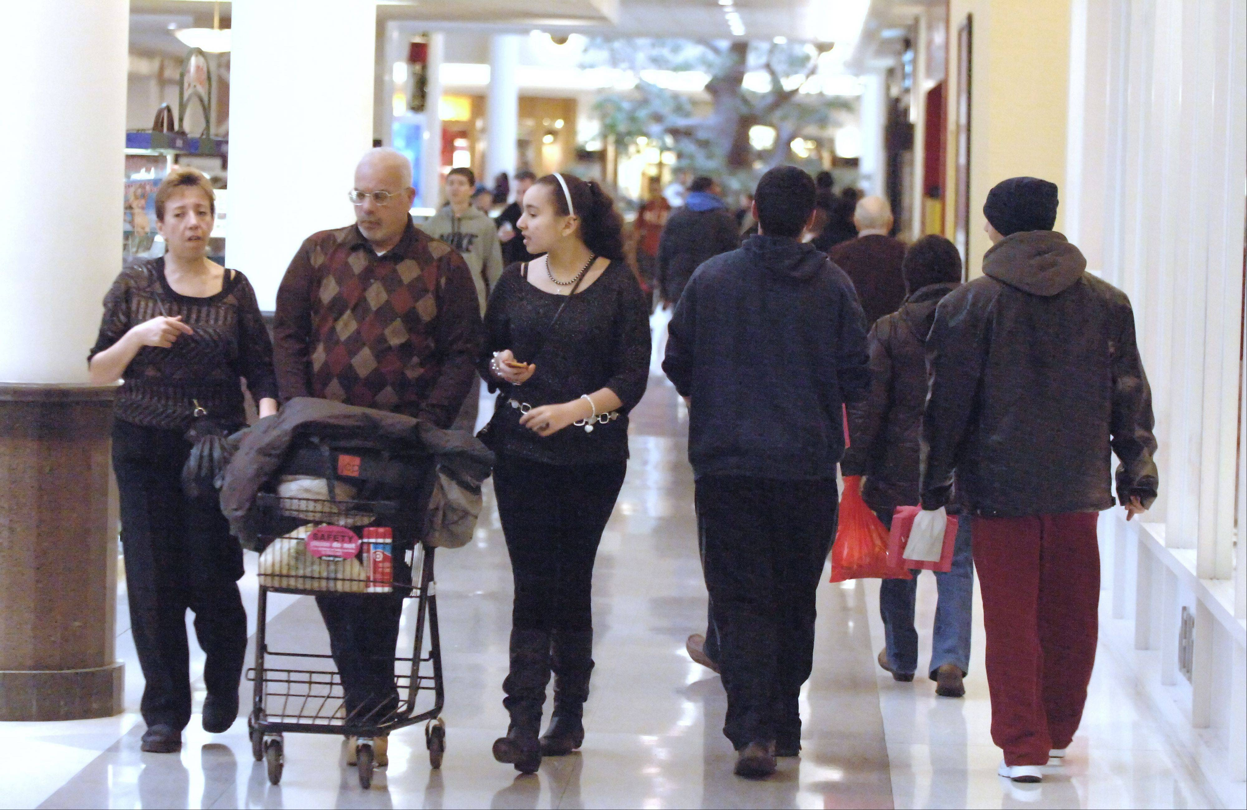 Last-minute shoppers scrambled Monday afternoon to find that special gift or stocking stuffer at Yorktown Mall in Lombard.