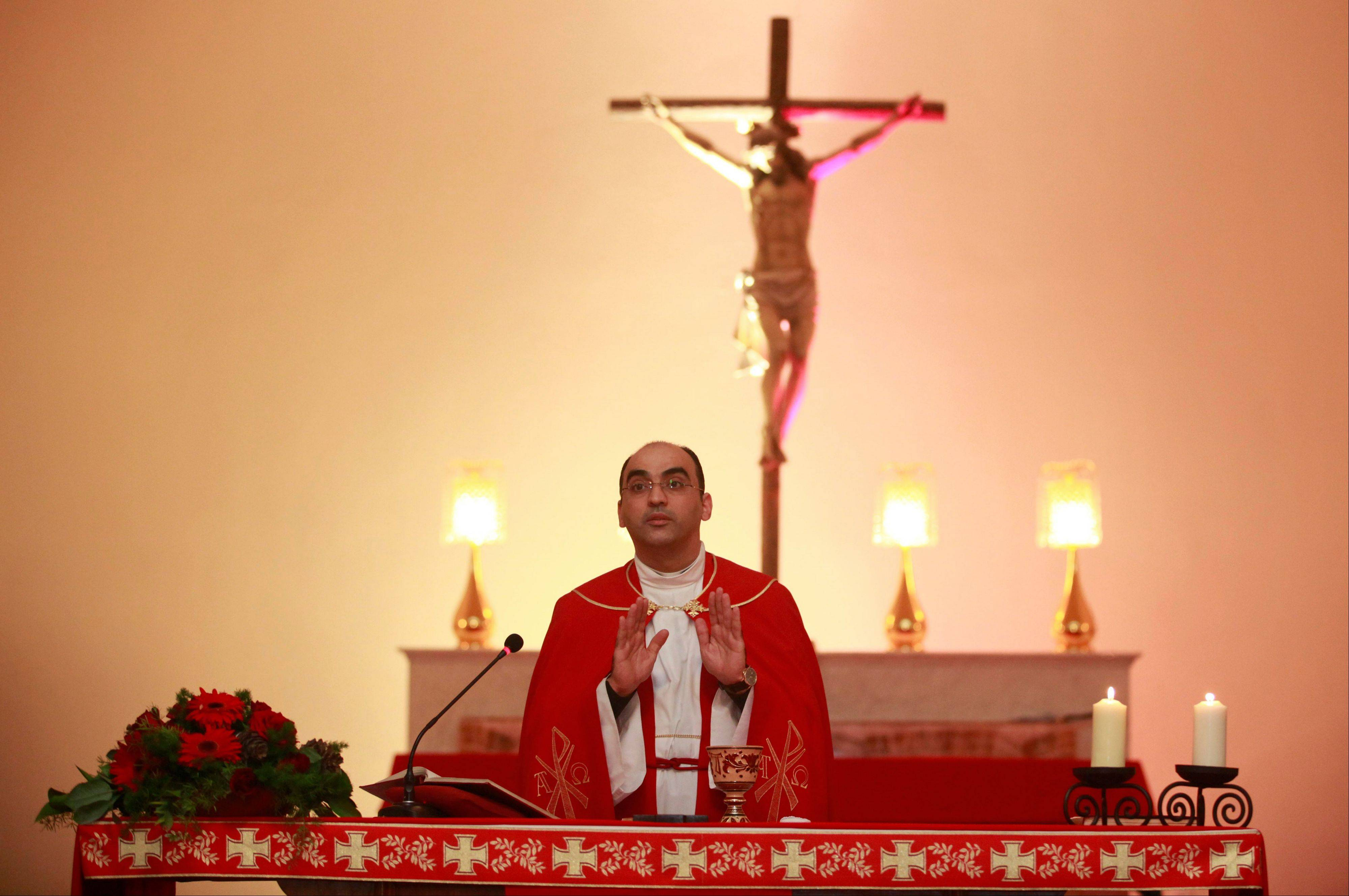 A Chaldean priest address the faithful during a Christmas Eve mass at St. Joseph's Chaldean Church in central Baghdad, Iraq, Monday, Dec. 24, 2012. Iraqi Christians gathered for Christmas Eve services amid tight security. The exact number of Christians remaining in Iraq is not known, but it has fallen sharply from as many as 1.4 million before the U.S.-led invasion nearly a decade ago. Community leaders believe there are about 400,000 to 600,000 Christians left in the country, according to figures from the U.S. State Department.