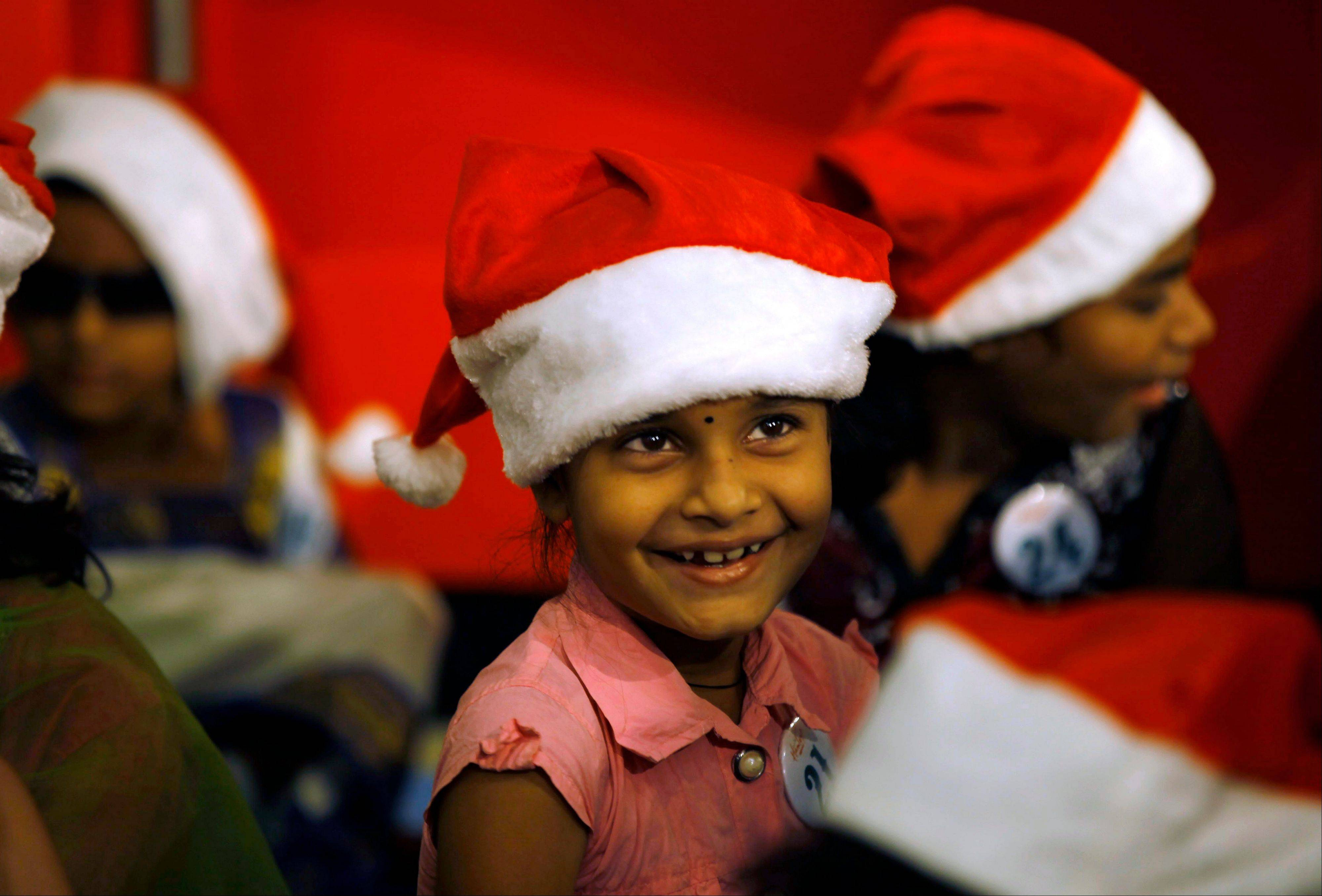 Special needs children take part in a Christmas celebration in Mumbai, India, Monday, Dec. 24, 2012. Although Christians comprise only two percent of the population Christmas is a national holiday and is observed across the country as an occasion to celebrate.
