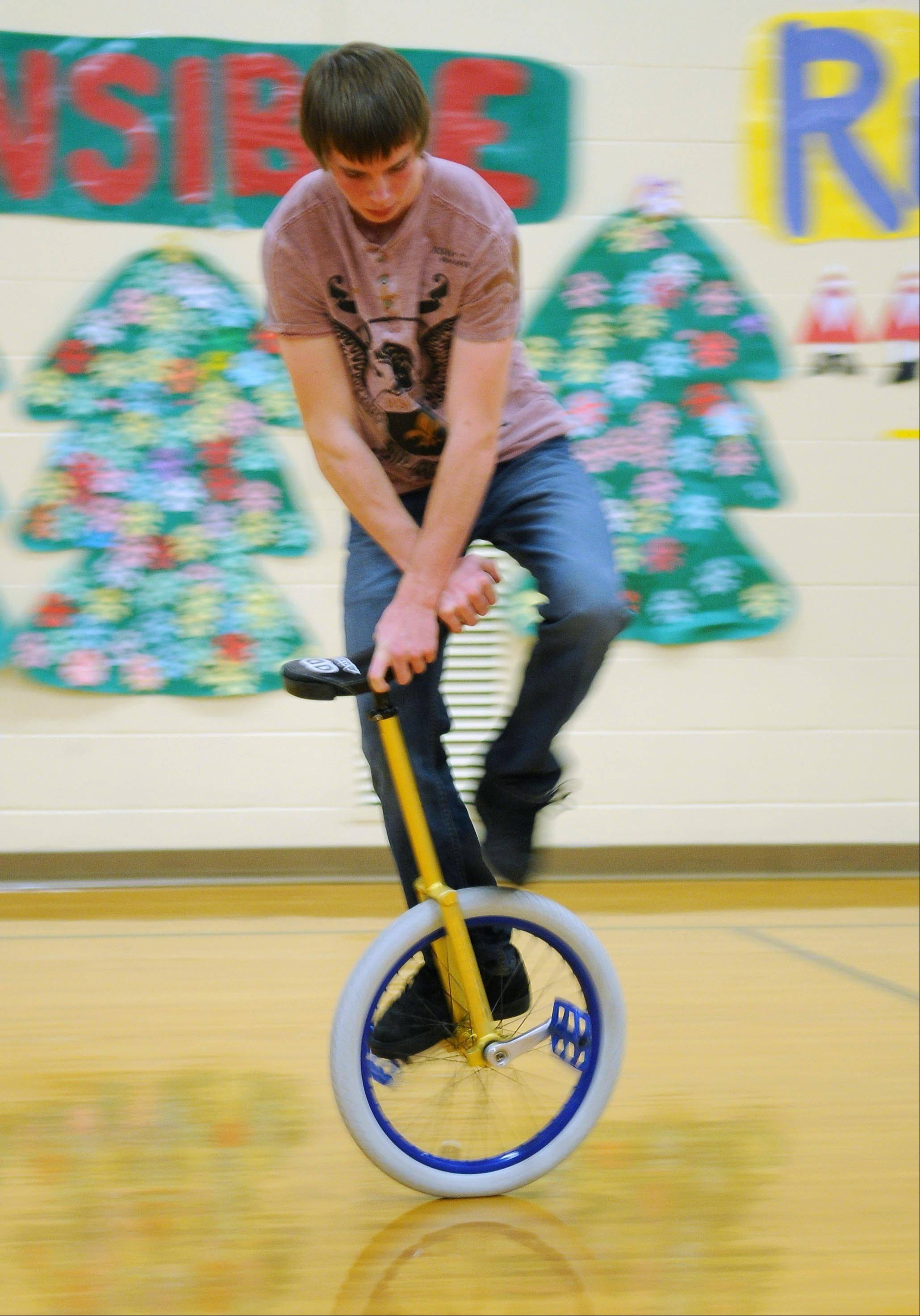 Ben Koehler, sixteen years-old, practices tricks on his unicycle in the gymnasium at St. Croix Central Elementary School in Roberts, Wis. Ben participates in a community education program hosted by the St. Croix Central School district that welcomes young and old to learn and master the unicycle with the assistance of the Twin Cities Unicycle Club.