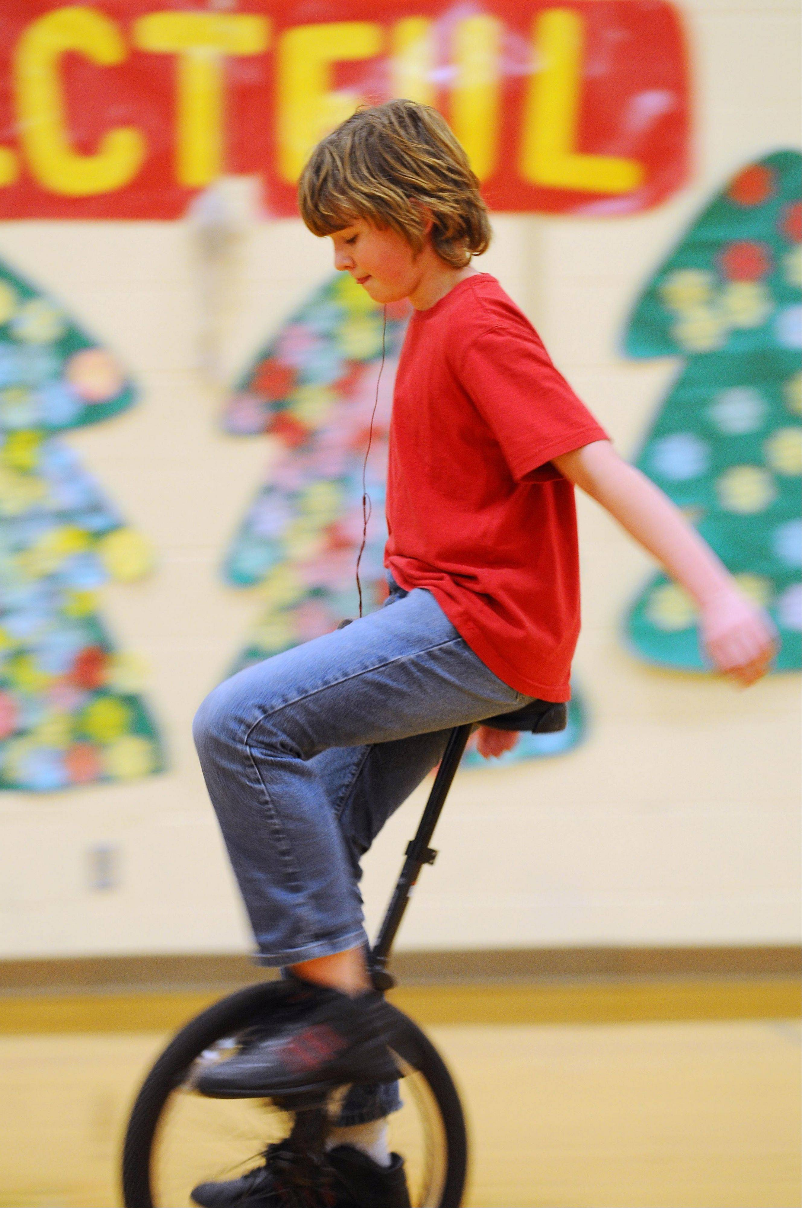 Ethen Jensen, thirteen years-old, rides a unicycle in the gymnasium at St. Croix Central Elementary School in Roberts, Wis. Ethan participates in a community education program hosted by the St. Croix Central School district that welcomes young and old to learn and master the unicycle with the assistance of the Twin Cities Unicycle Club.