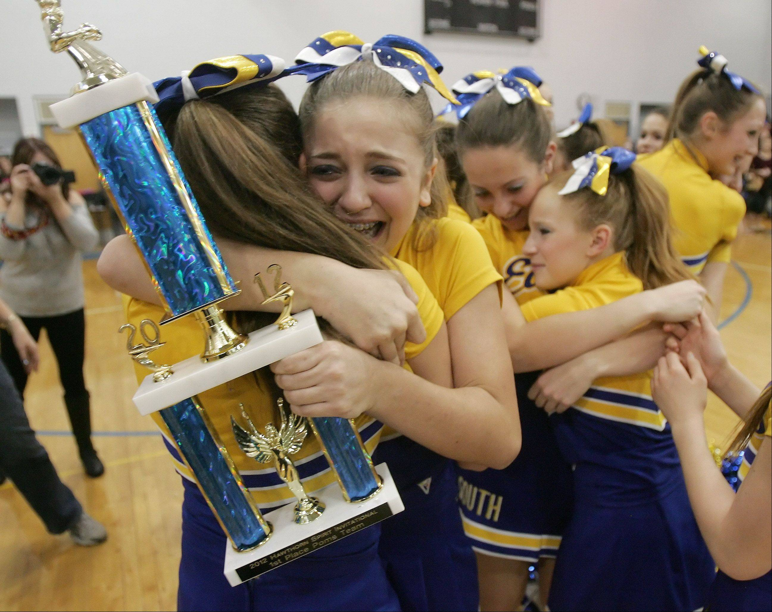 Captains Ellie Blumenfeld, center, and Ally Ripes hug after Hawthorn Middle School South won first place in the pom competition during the 13th Annual Hawthorn Spirit Invitational Sunday at Hawthorn Middle School South in Vernon Hills. The event featured Lake County middle school teams competing in pom and cheerleading routines.