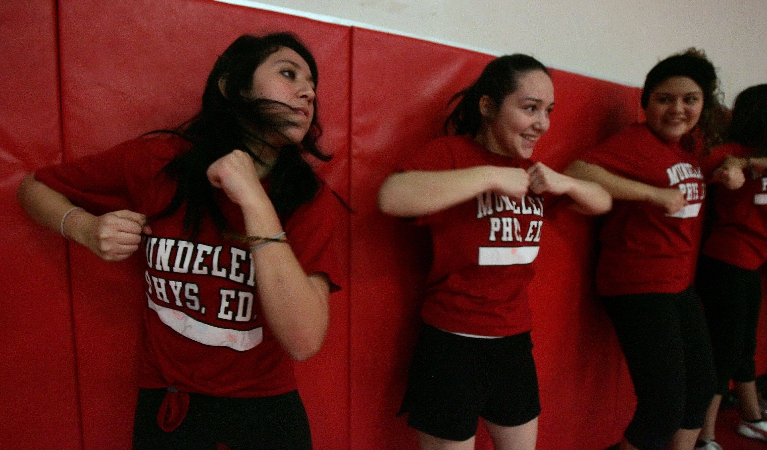 Sophomores Jocelyn Acosta, left, and Adriana Santoro practice elbow punches during a women's self-defense class conducted by the Mundelein Police Department Wednesday at Mundelein High School. The class taught basic defensive moves for teenage girls in case of attack.