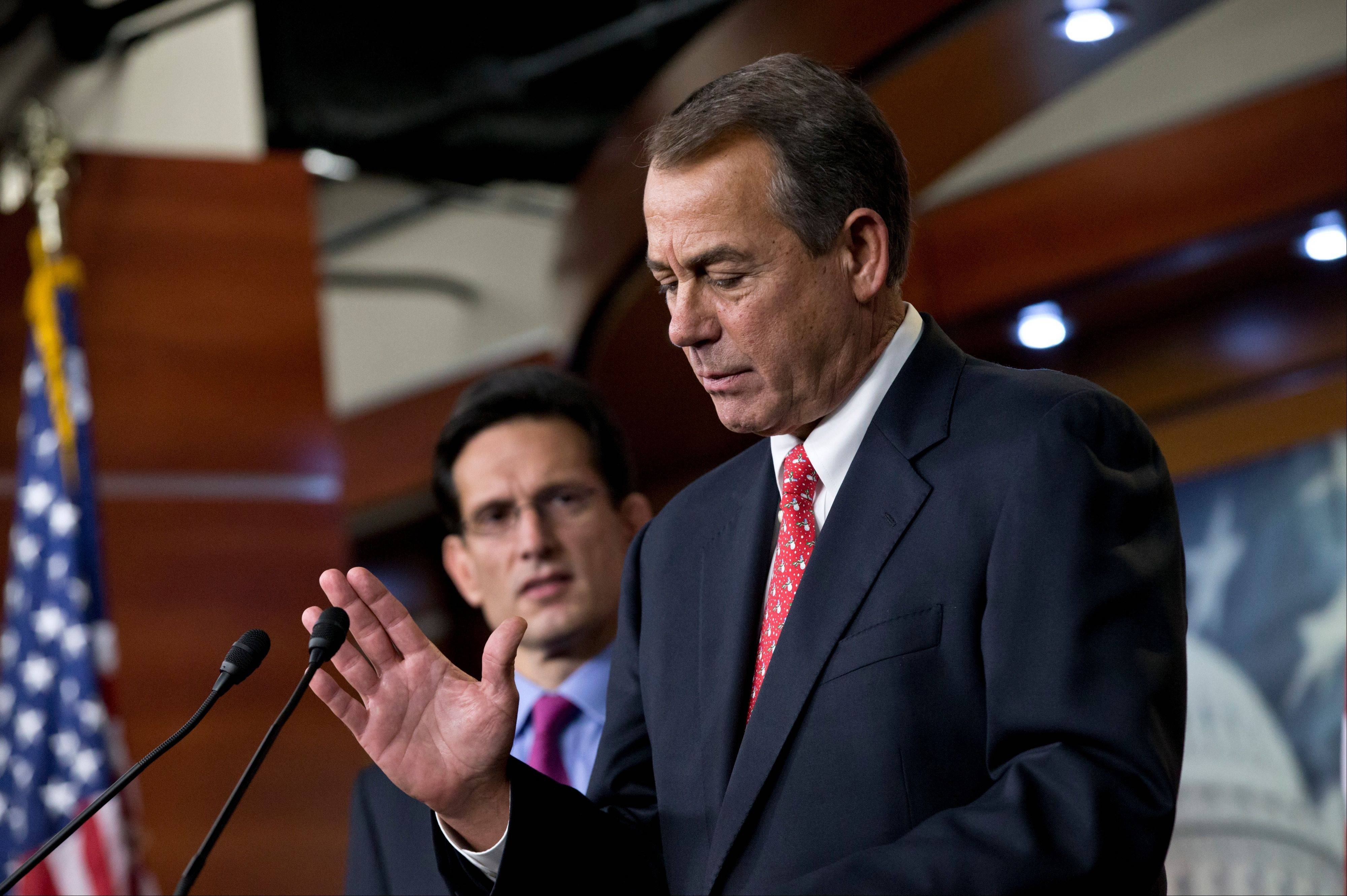 Speaker of the House John Boehner, an Ohio Republican, joined by House Majority Leader Eric Cantor, a Virginia Republican, left, speaks to reporters about the fiscal cliff negotiations at the Capitol in Washington.