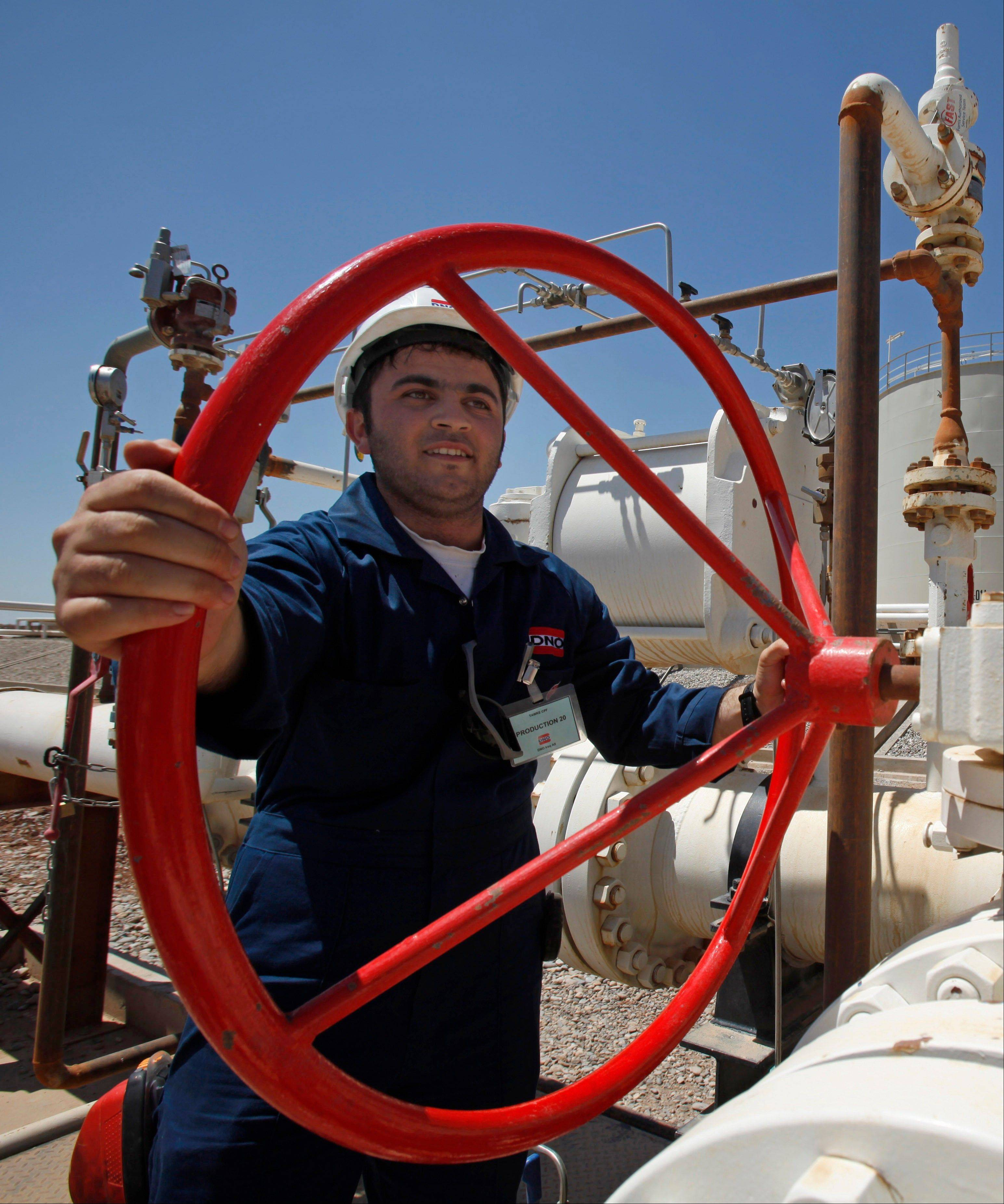An employee works at the Tawke oil fields in the semiautonomous Kurdish region in northern Iraq. An Iraqi Kurdish official says the country�s self-ruled northern Kurdish region has suspended oil exports over a payment row with the central government in Baghdad.