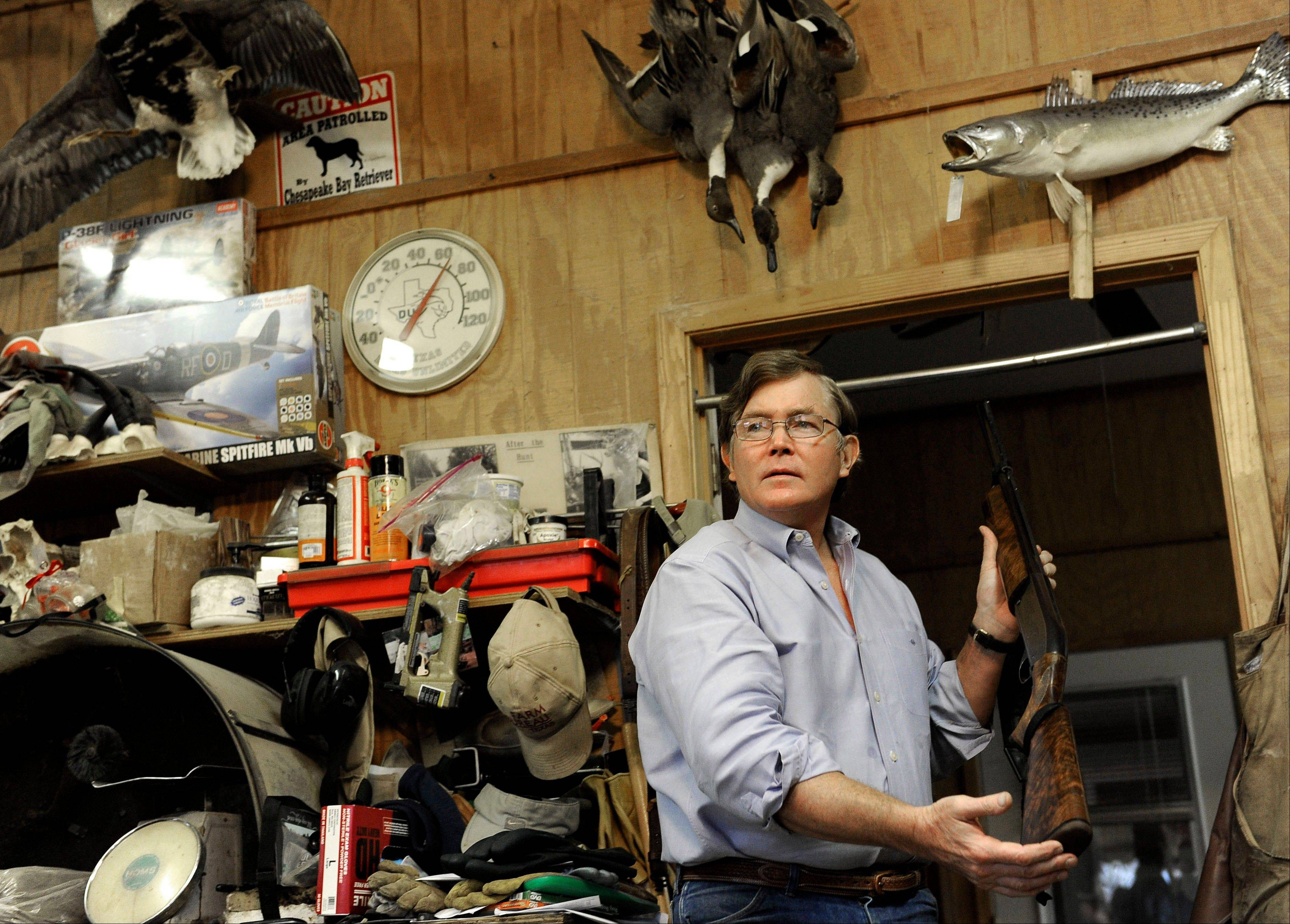 Taxidermist Bill Moos displays one of his shotguns last week in his shop in Bryan, Texas. Moos, who owns a collection of more than 30 guns, can be spotted any given morning, prowling his roughly 40-acre ranch with his dogs and a shotgun slung over his shoulder.