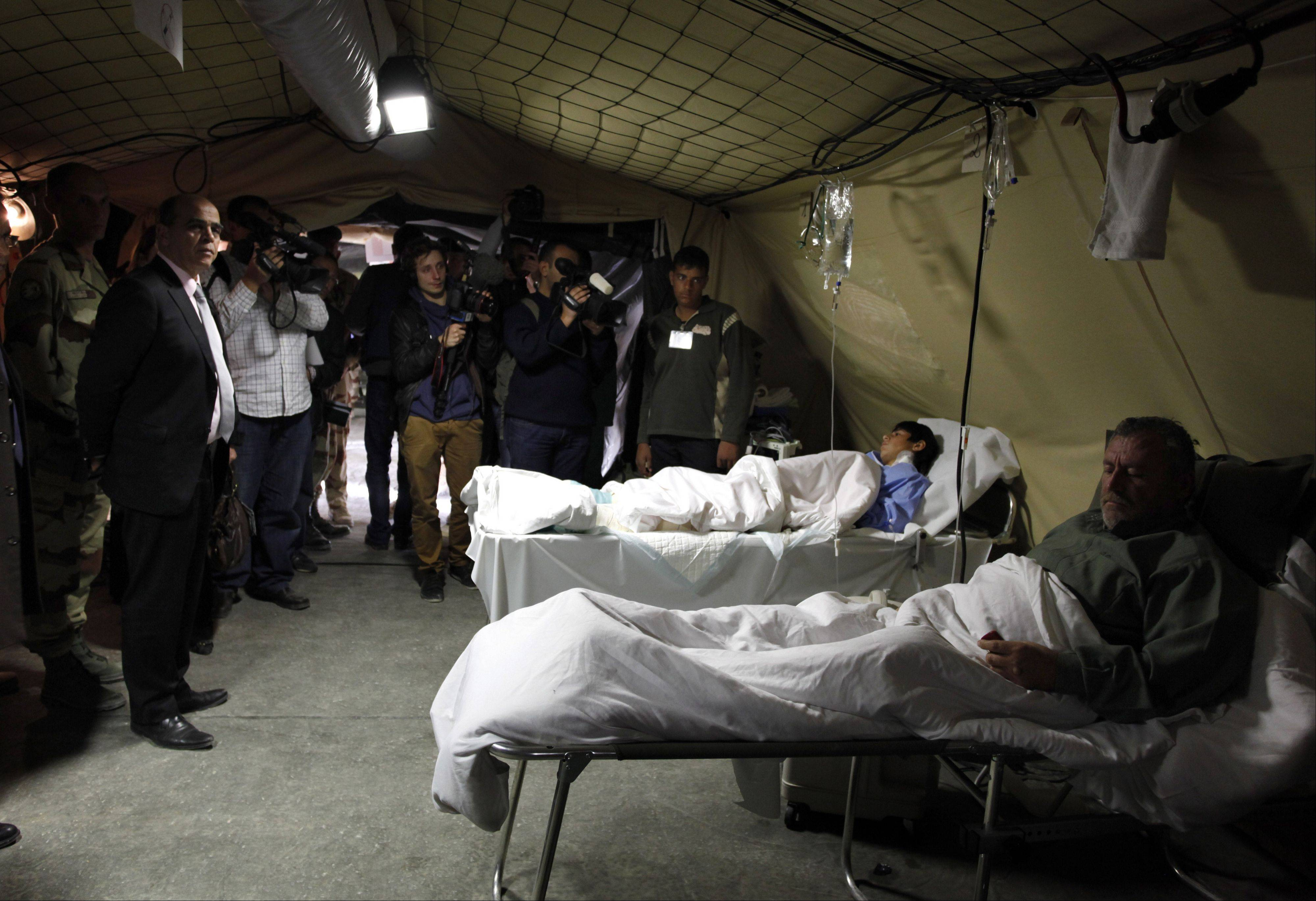 Kader Arif, French Minister for Veteran affairs, second from left, visits Tuesday one of the tents of the French military mobile hospital at Zaatari Syrian refugee camp, near the Syrian border in Mafraq, Jordan.