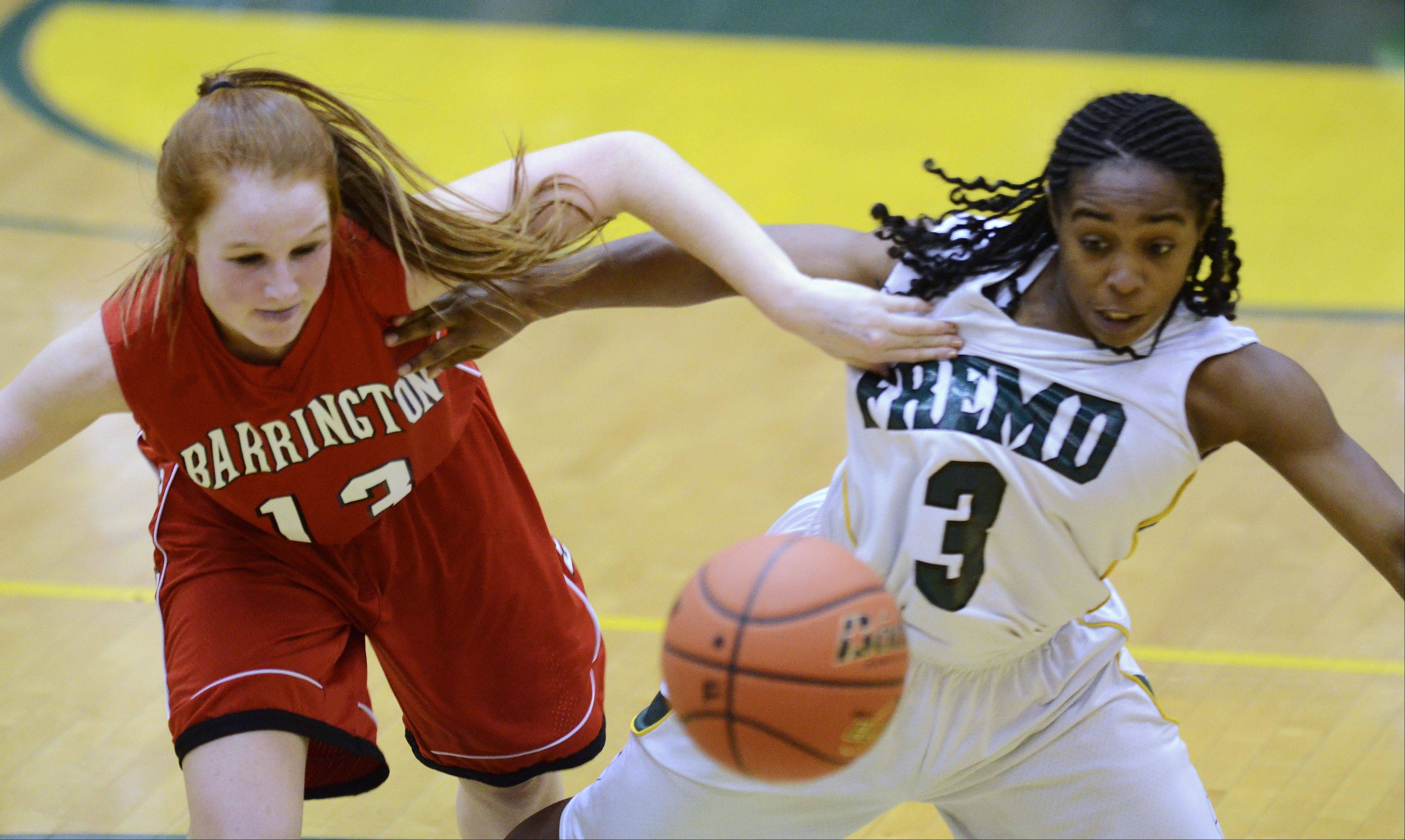 Barrington�s Carrie Madden, left, and Fremd�s Brianna Lewis chase down the ball during Friday�s game.